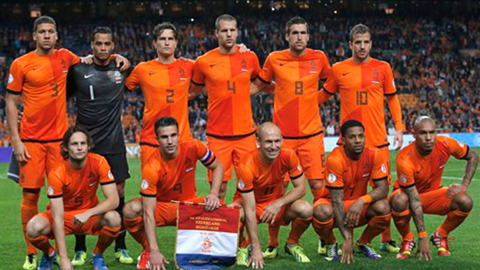 FILE - In this Oct. 11, 2013 file photo, Dutch soccer team poses prior the start the Group D World Cup qualifying soccer match between Netherlands and Hungary, at Arena stadium in Amsterdam, Netherlands. Background from left: Jeffrey Bruma, Michel Vorm, Daryl Janmaat, Ron Vlaar, Kevin Strootman, and Rafael van der Vaart. Foreground from left: Daley Blind, Robin van Persie, Arjen Robben, Jeremain Lens and Nigel de Jong. (AP Photo/Peter Dejong, File) - SEE FURTHER WORLD CUP CONTENT AT APIMAGES.COM