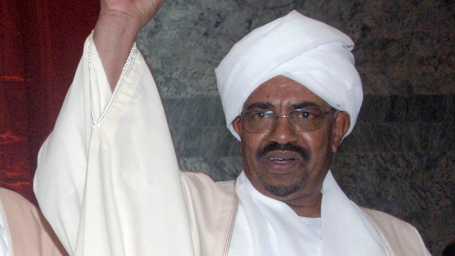 May 27: Sudan's president Omar al-Bashir gestures prior to being sworn in, at the parliament in Khartoum, Sudan. (AP)
