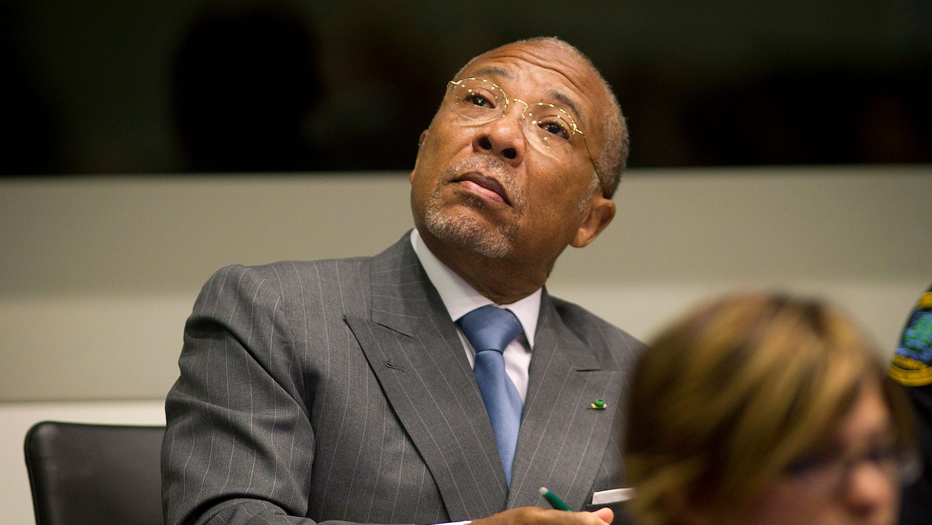 May 16, 2012: Former Liberian President Charles Taylor looks up to the public gallery as he waits for the start of his sentencing hearing in Leidschendam, near The Hague, Netherlands.