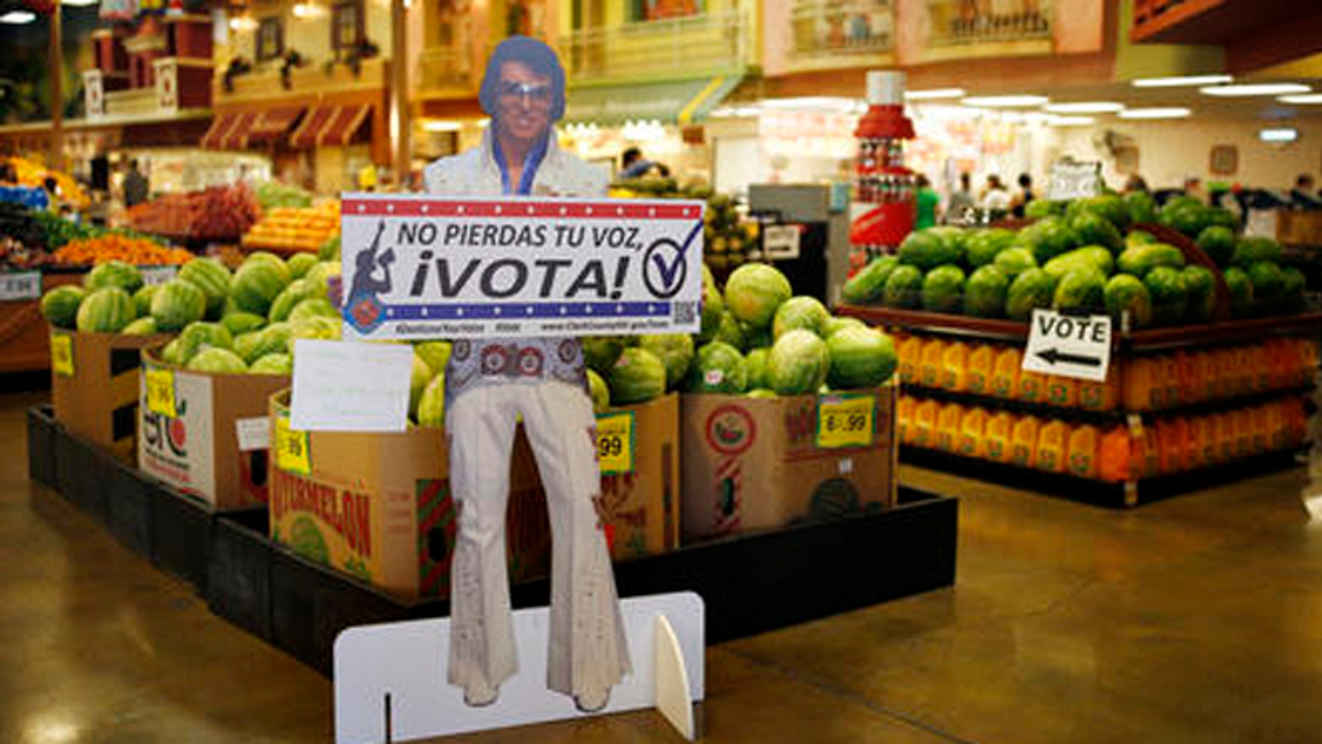 """A sign in Spanish which translates, """"Don't Lose Your Voice, Vote!"""" is displayed near a polling place in a Cardenas supermarket in Las Vegas on Friday, June 10, 2016. In the battleground state of Nevada, some 17 percent of eligible voters are Hispanics. Here, Latinos have clearly demonstrated the power they wield when they either turn out or stay home. In 2008 and 2012 they helped President Barack Obama; they were critical in re-electing Sen. Harry Reid in 2010. In the 2014 midterms, though, Hispanic turnout plummeted, and Republicans swept every statewide office and won control of both houses of the Legislature for the first time since 1929. (AP Photo/John Locher)"""