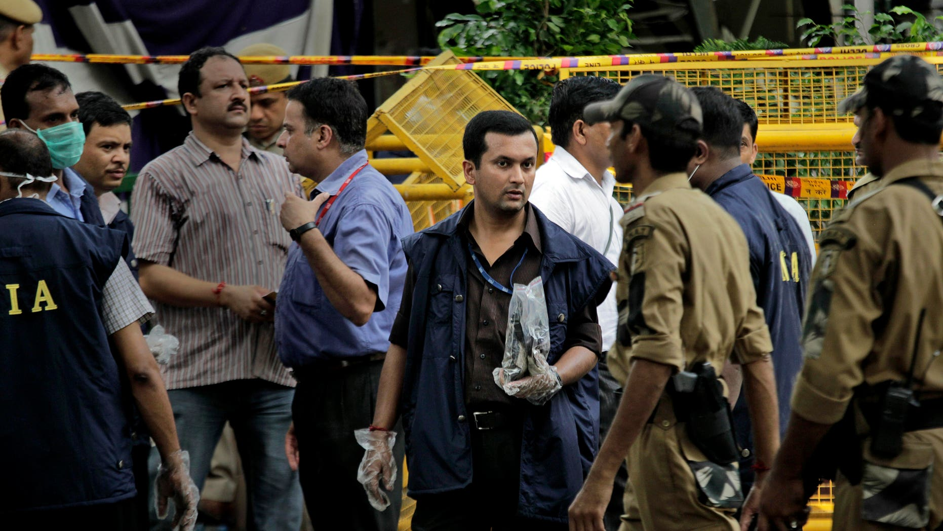 September 8: An officer of the National Investigation Agency (NIA) stands with the evidence collected from the site of a blast at Delhi High court in New Delhi, India.