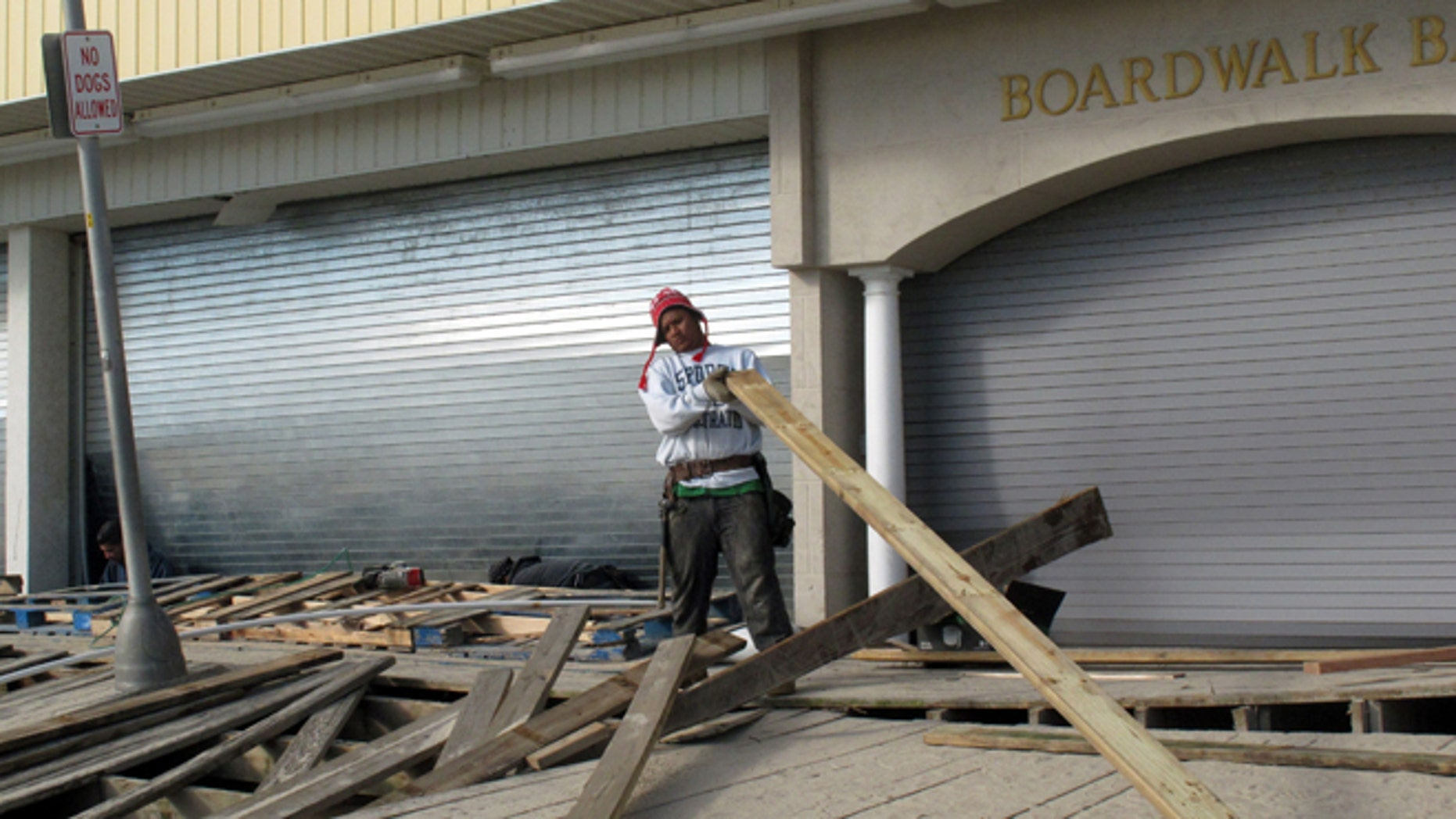 FILE: Nov. 1, 2012:  A worker repairs the Point Pleasant Beach, N.J., boardwalk after Superstorm Sandy wrecked parts of it.