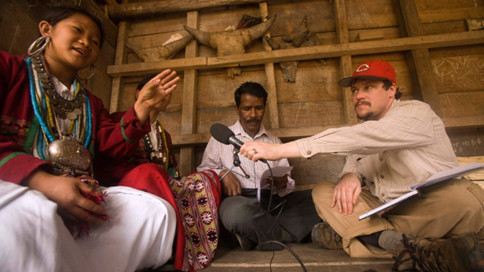 Kachim, a speaker of the hidden language Koro, talks to National Geographic Fellow Gregory Anderson. Anderson and a team made the first known recordings of Koro, an endangered language that is new to science.