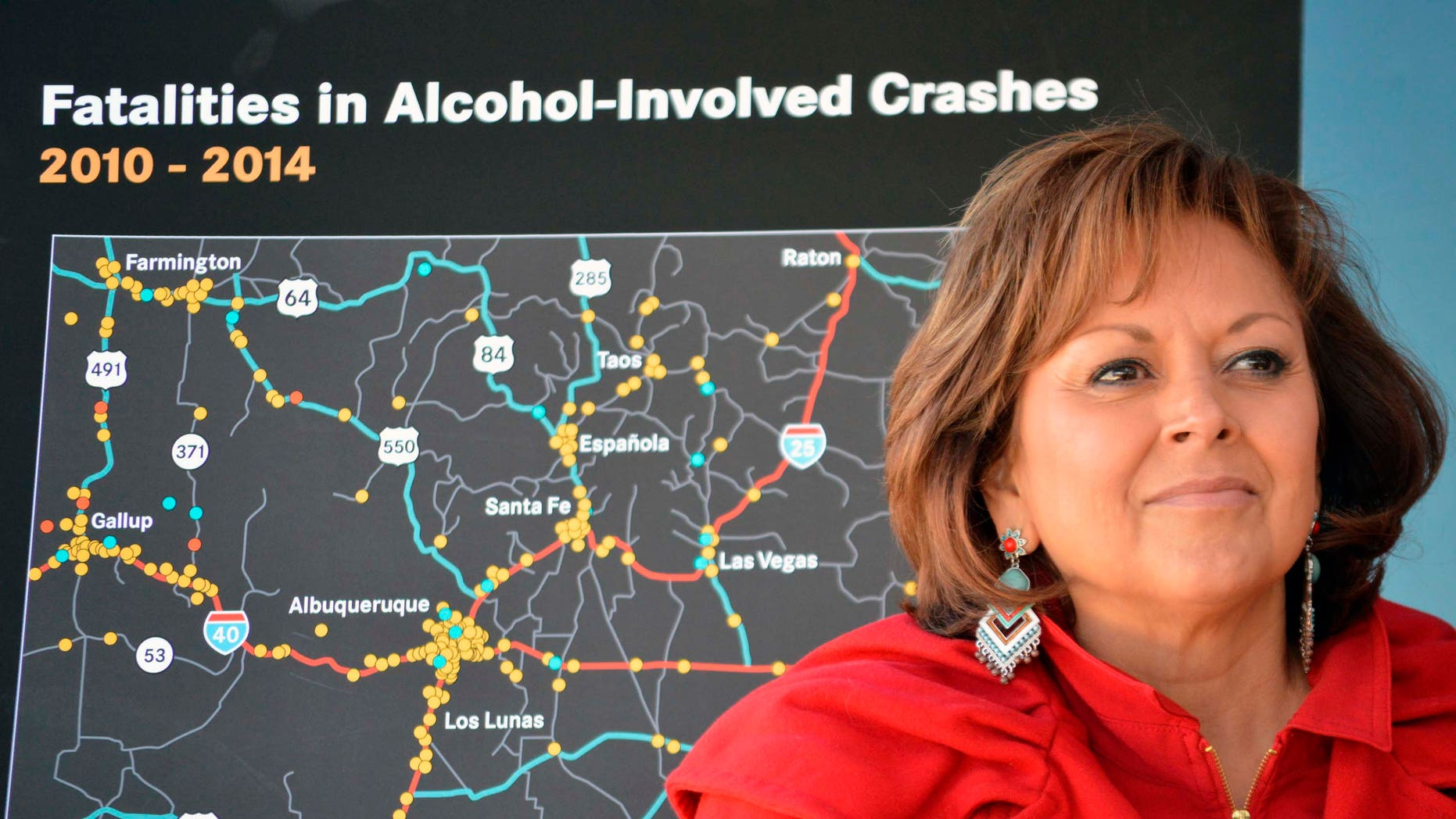 New Mexico Gov. Susana Martinez stands in front of a state map of drunken-driving deaths during a news conference in Albuquerque, N.M. on Monday, Dec. 7, 2015. A recording from a Santa Fe police sergeant's belt tape suggests  Martinez was inebriated the night police responded to a complaint at a downtown hotel where the governor was hosting a holiday party. Santa Fe Police released the recording, Tuesday, Dec. 22, 2015, shedding more light on the Dec. 13 incident at the Eldorado Hotel and Spa. A clerk initially called dispatchers to report noise and that someone was throwing bottles from a hotel balcony. (AP Photo/Russell Contreras, File)