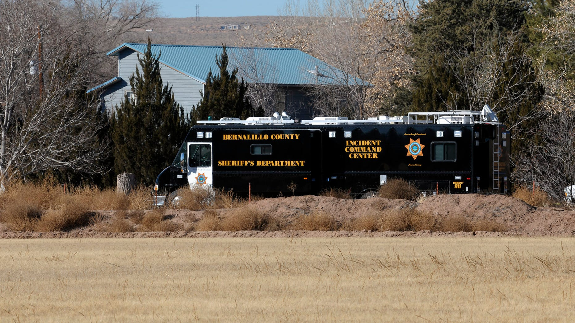 Jan. 20, 2013: BCSO deputies and crime scene personnel work the scene of a five person homicide on Long Lane SW, in Albuquerque, NM. Authorities said a teenage boy fatally shot two adults and three children at a home near Albuquerque.