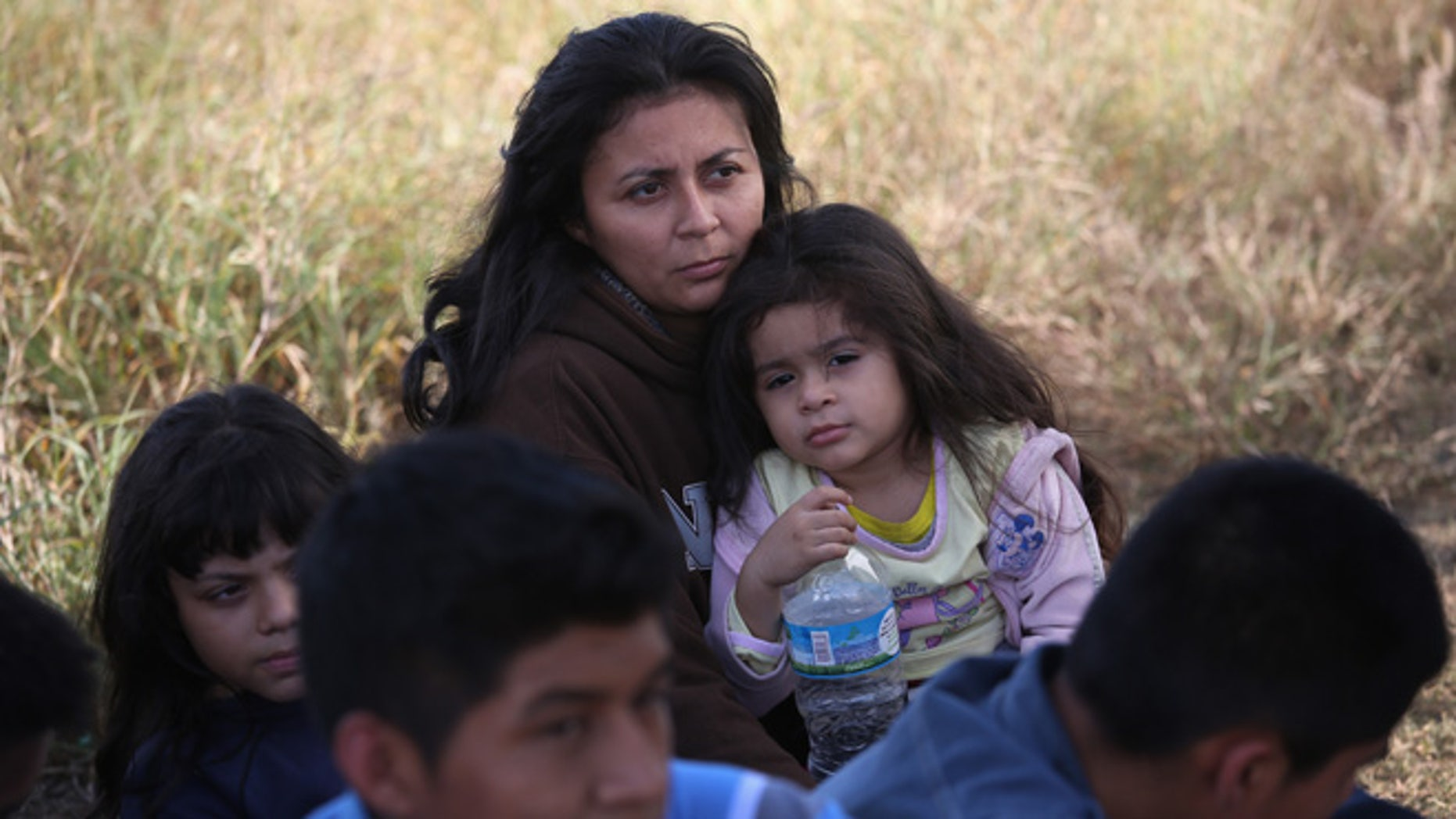 A Honduran mother holds her daughter, 3, after she turned her family in to U.S. Border Patrol agents on December 8, 2015 near Rio Grande City, Texas. They had just illegally crossed the U.S.-Mexico border into Texas. (Photo by John Moore/Getty Images)