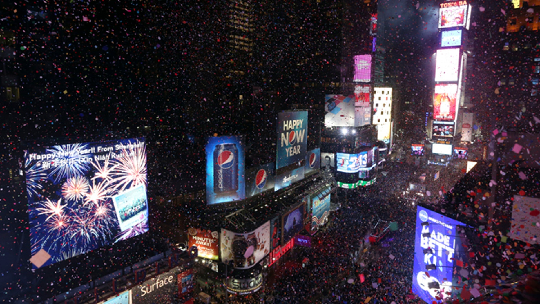 Confetti flies over New York's Times Square after the clock strikes midnight during the New Year's Eve celebration in 2013.