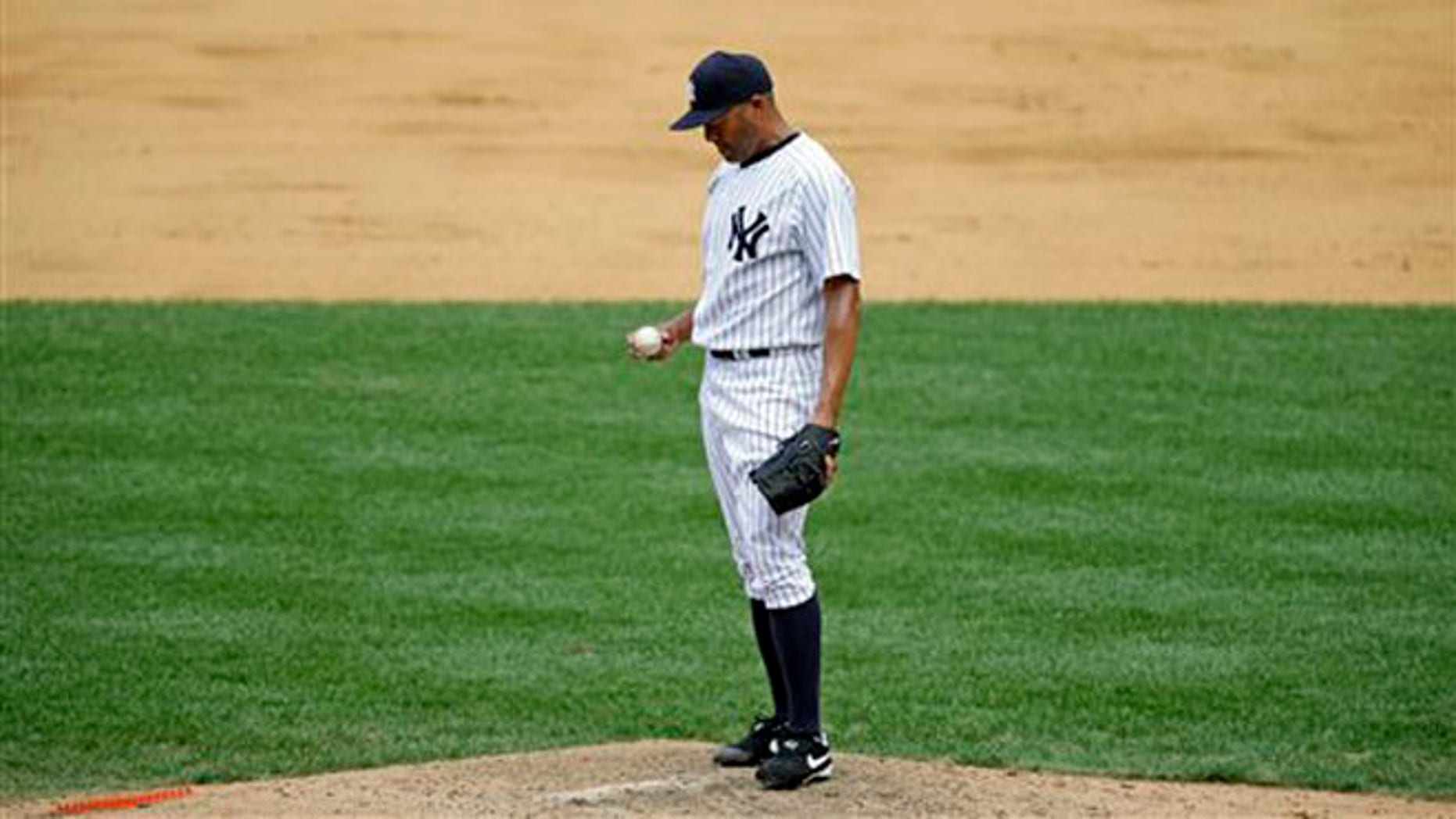 New York Yankees closer Mariano Rivera after allowing a ninth-inning, game-winning, two-run home run to Baltimore Orioles Adam Jones in a baseball game, Sunday, July 7, 2013, in New York.