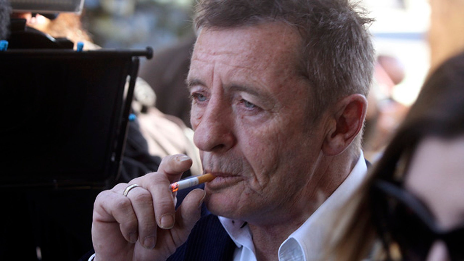 FILE - In this Thursday, July 9, 2015 file photo, former AC/DC drummer Phil Rudd arrives for sentencing at the Tauranga District Court in Tauranga, New Zealand. Rudd has been arrested in New Zealand, just 10 days after he was sentenced to home detention for threatening to kill a man who used to work for him. (Alan Gibson/New Zealand Herald via AP, File) NEW ZEALAND OUT, AUSTRALIA OUT