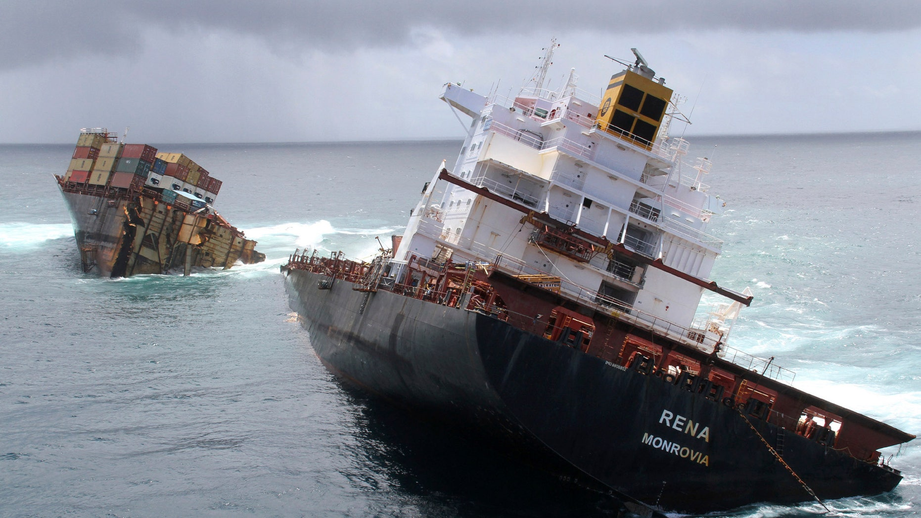Jan. 9, 2012: The cargo ship Rena is split in two and sits on a reef near Tauranga, New Zealand. The captain and the navigating officer of the ship that ran aground on the reef last year pleaded guilty Wednesday, Feb. 29, 2012 to a series of charges.