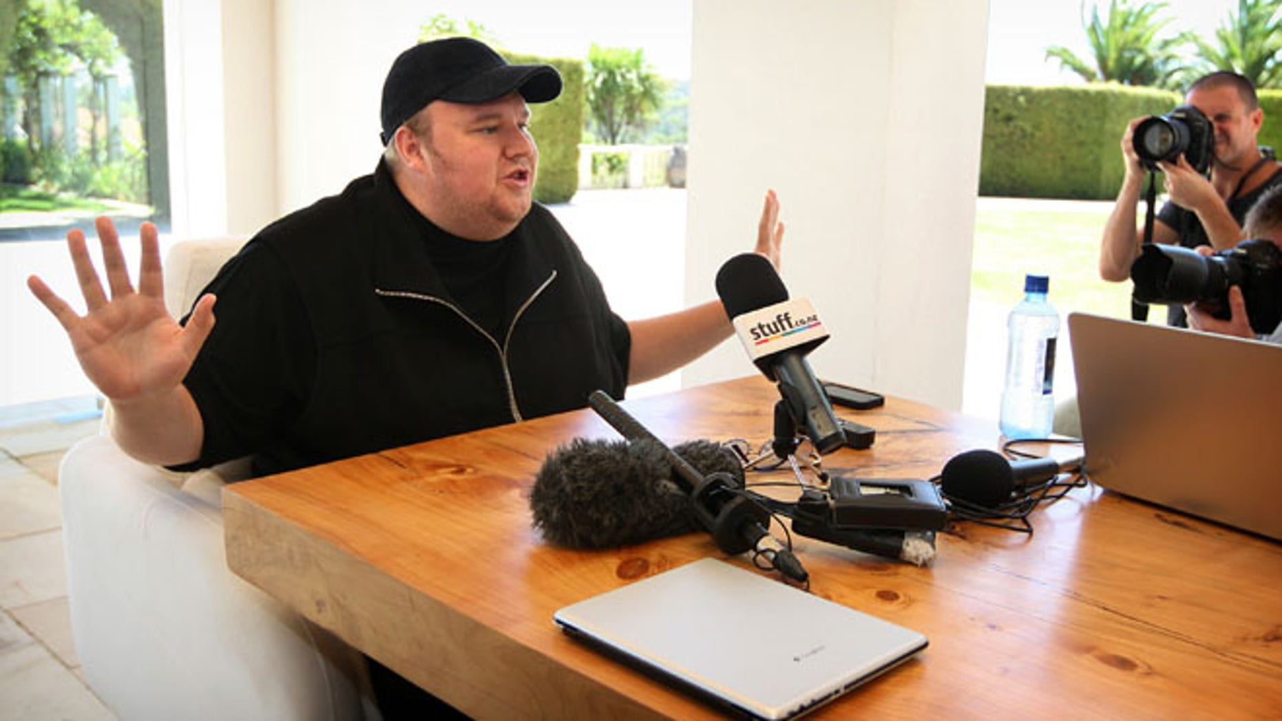 "Jan. 20, 2013: Indicted Megaupload founder Kim Dotcom holds a press conference ahead of the launch of a new file-sharing website called ""Mega"" at his Coatesville mansion in Auckland, New Zealand."