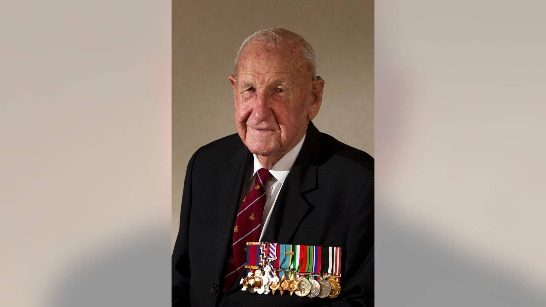 "In this March 3, 2015, photo, veteran Les Munro poses for a photo at his home in Tauranga, New Zealand. Munro, 96, the last surviving pilot from the specialized World War II ""Dambuster"" mission targeting German infrastructure died Tuesday, Aug. 4, 2015. (Alan Gibson/New Zealand Herald via AP) NEW ZEALAND OUT, AUSTRALIA OUT"