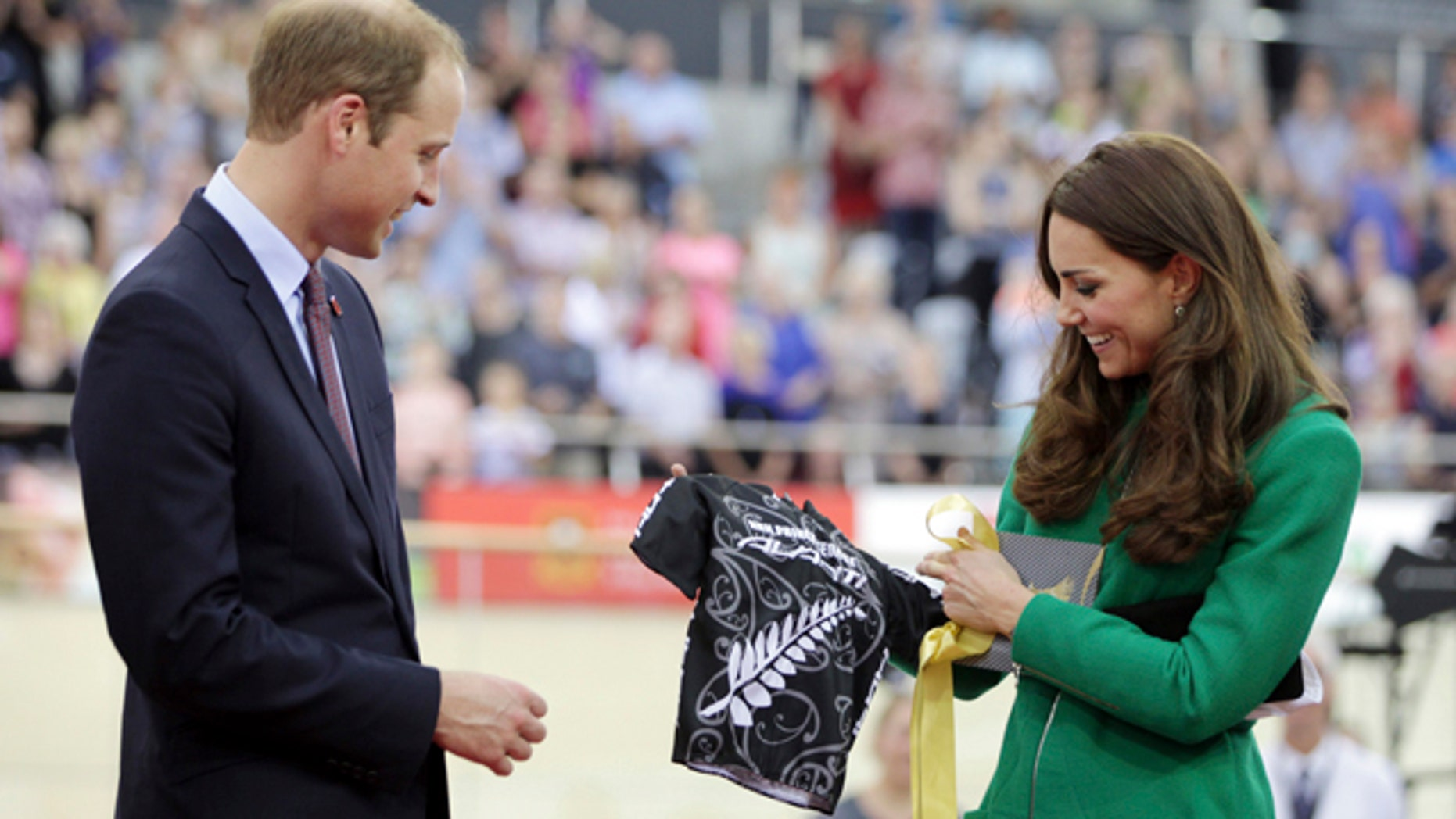 April 12, 2014: Britain's Prince William, left, and Kate, Duchess of Cambridge, look at a cycling shirt presented to them for their son Prince George while attending the opening of the National Cycling Centre in Cambridge, New Zealand. (AP Photo/Peter Drury, Pool)