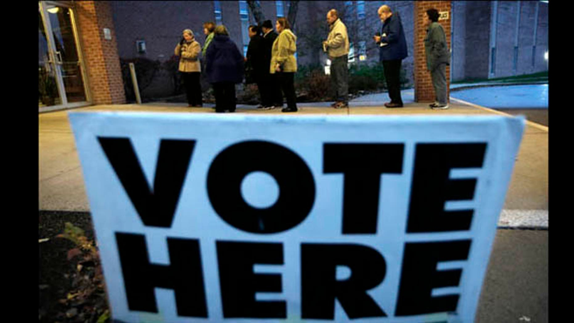 Nov. 6, 2012: Voters wait in line for the doors to Precinct 39 to open before casting their ballots on Election Day.