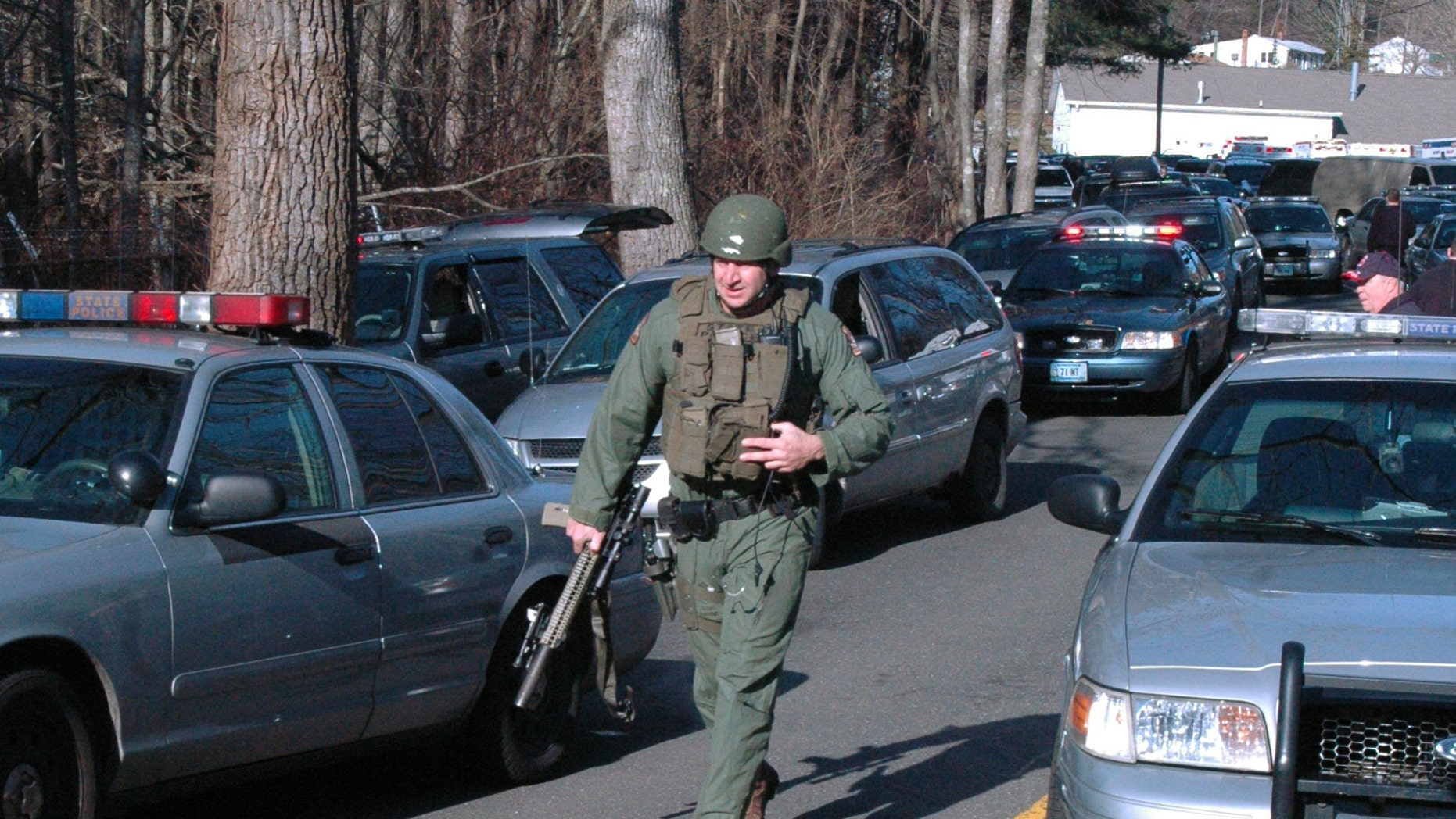 Dec. 14, 2012: In this photo provided by the Newtown Bee, police officers are on the scene outside Sandy Hook Elementary School in Newtown, Conn., where authorities say a gunman opened fire, killing 26 people, including 20 children.