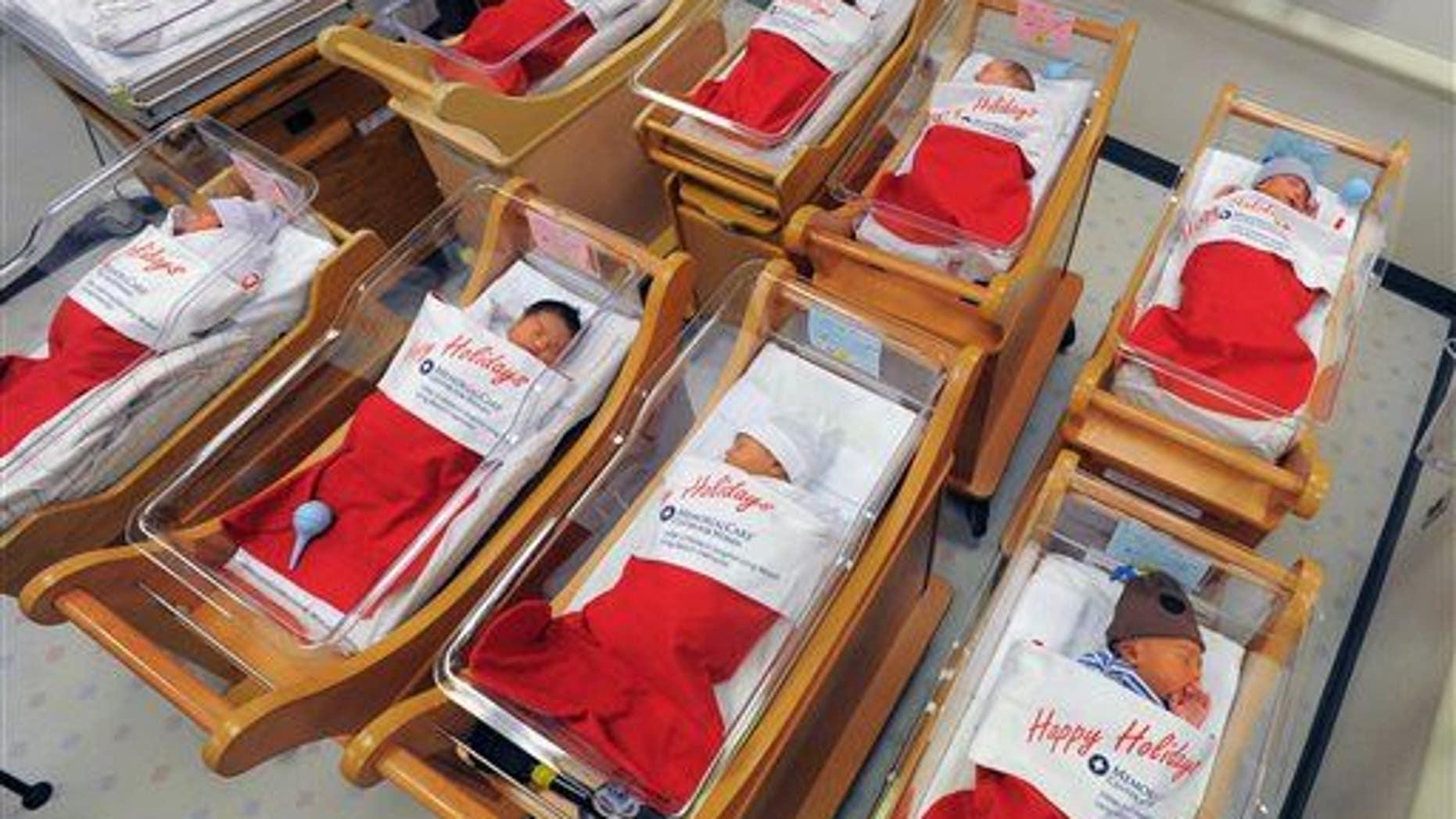 Newborns sleep in oversized red stockings in the nursery at Long Beach Memorial in Long Beach, Calif., on Monday, Dec. 23, 2013.