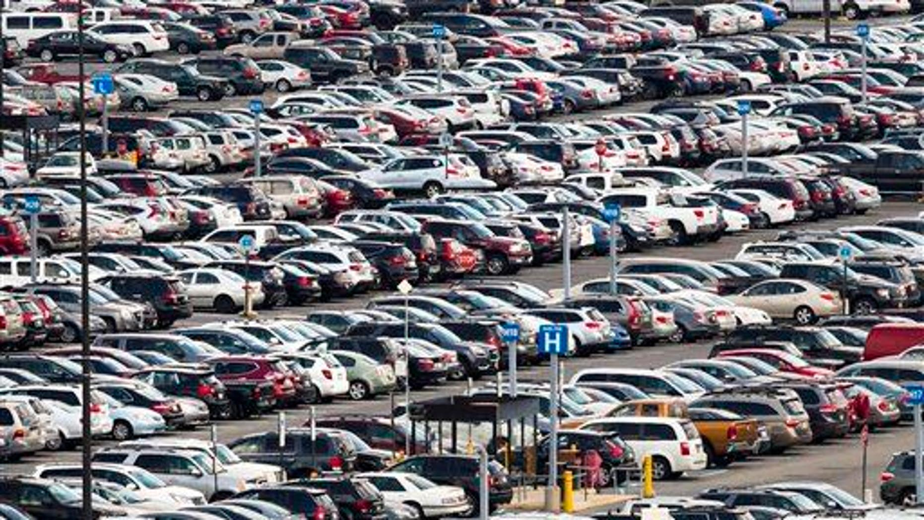 Cars are parked at the Philadelphia International Airport, Thursday, July 17, 2014, in Philadelphia.