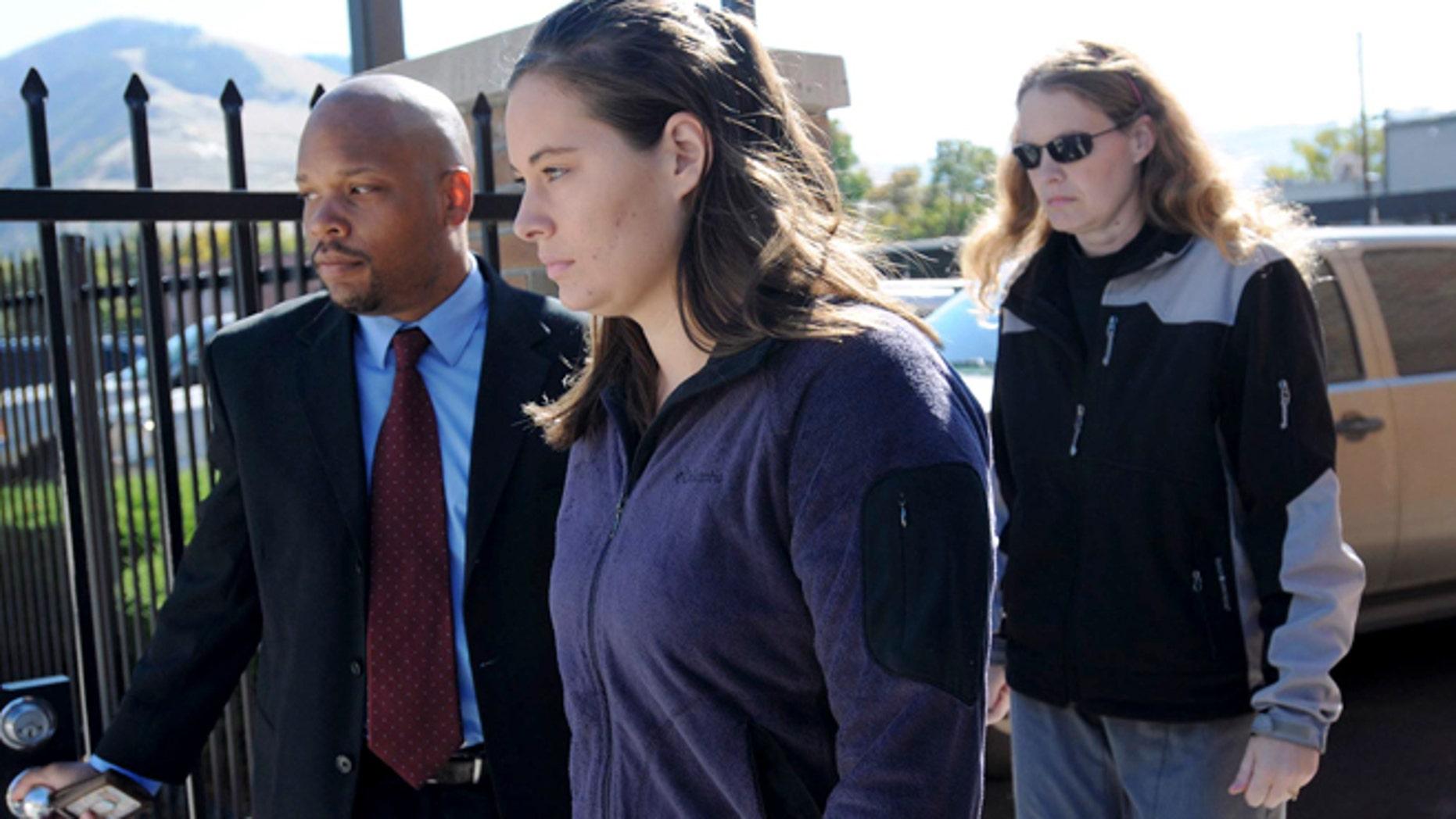 Oct. 4, 2013: In this file photo, Jordan Linn Graham, center, leaves federal court, in Missoula, Mont.
