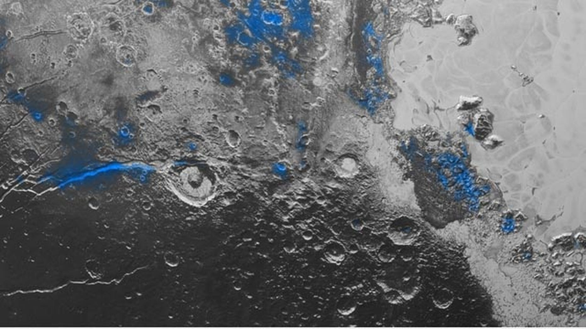 Oct. 8, 2015: This image released by NASA shows regions with exposed water ice highlighted in blue in this composite image taken with the New Horizons spacecraft's Ralph instrument. The image combines visible imagery from the Multispectral Visible Imaging Camera (MVIC) with infrared spectroscopy from the Linear Etalon Imaging Spectral Array (LEISA).  The scene is approximately 280 miles across. (NASA/JHUAPL/SwRI via AP)