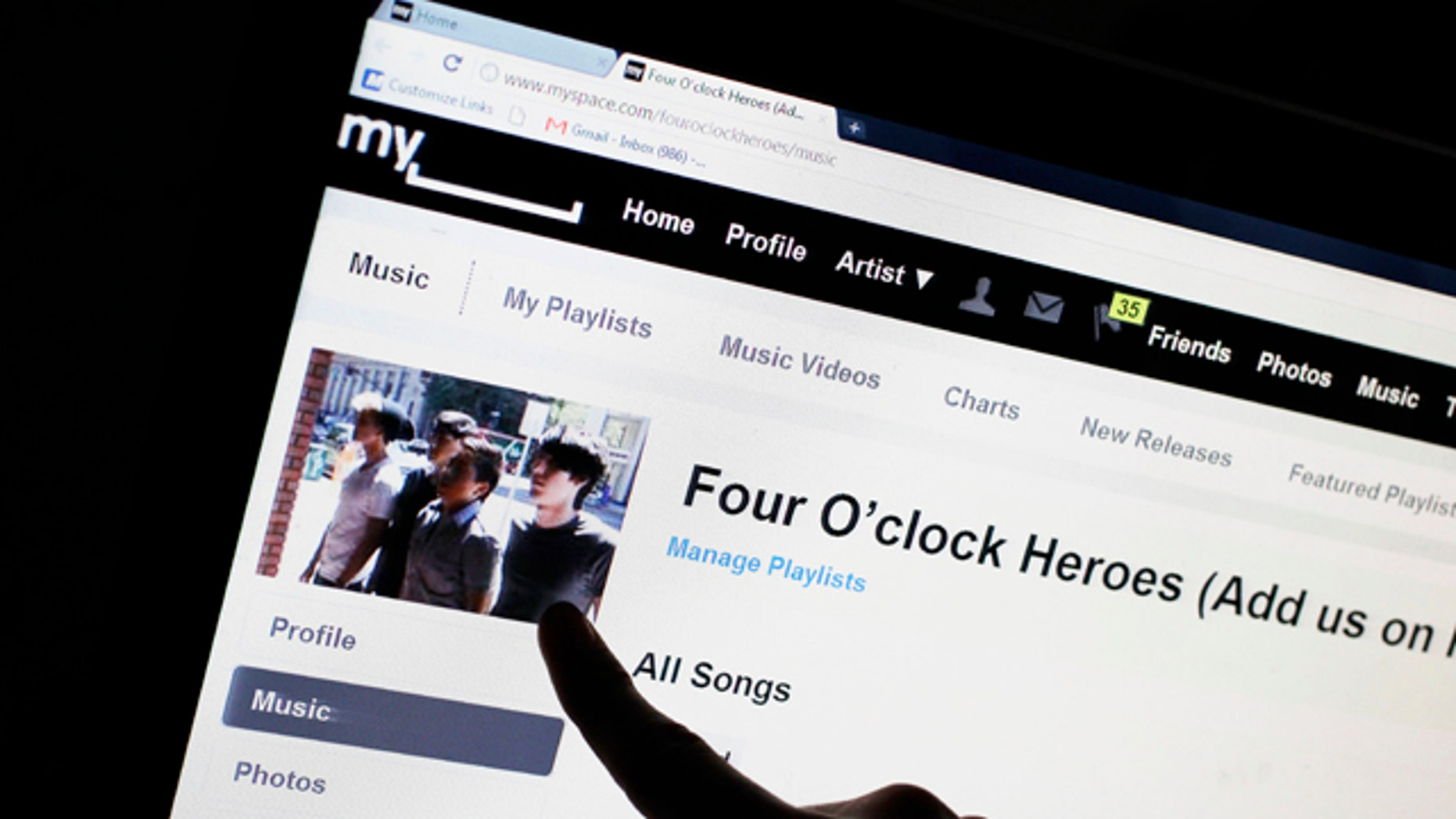 June 29, 2011: Bass guitarist Cameron Schnittger, with the pop rock band Four O'clock Heroes, points to his picture on on the bands' MySpace web site page in San Jose, Calif. News Corp. has sold the struggling social networking site for $35 million, mostly in stock, according to a person familiar with the matter.