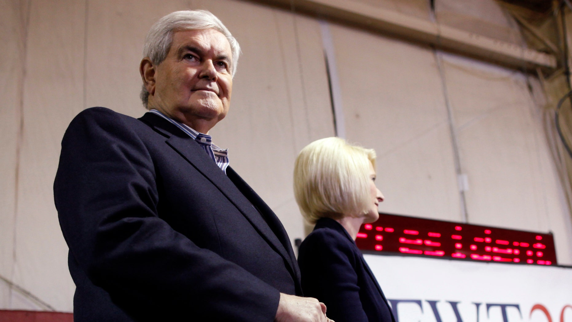 Republican presidential candidate former Speaker Newt Gingrich, stands with his wife Callista as he is introduced at his campaign headquarters in Davenport, Iowa, Monday, Jan. 2, 2012. (AP Photo/Charles Dharapak)