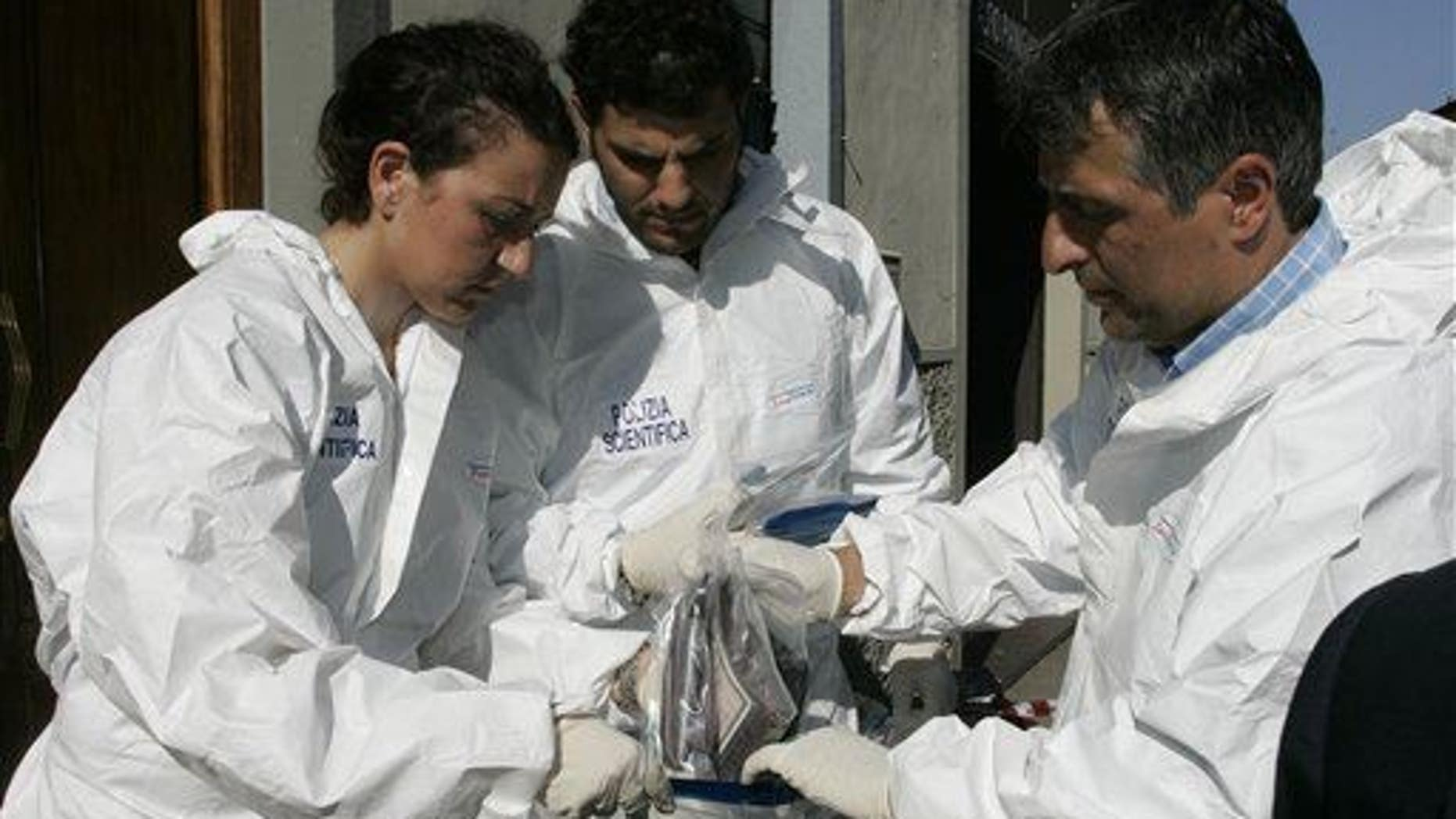 Forensic police officers are shown.