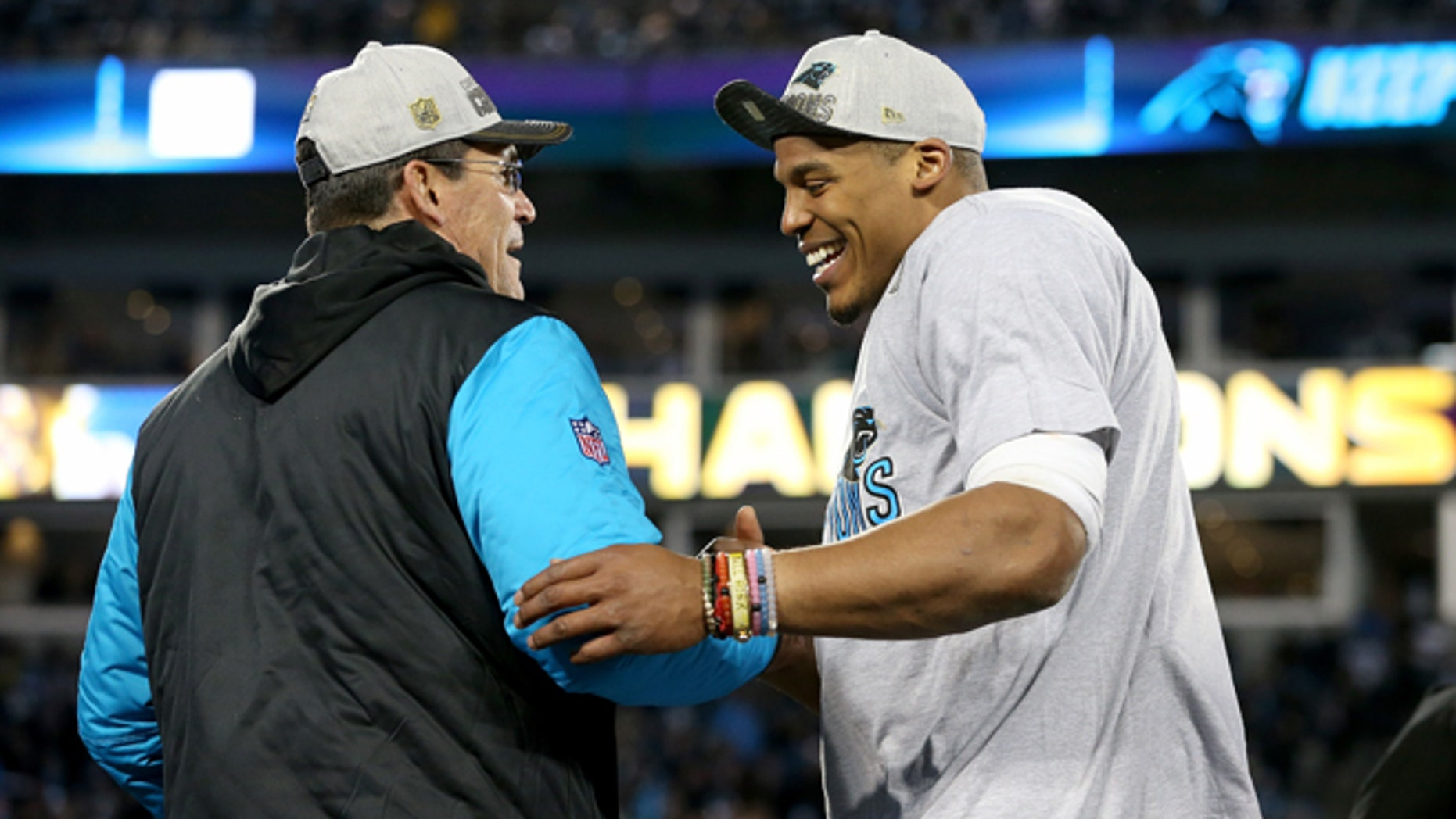 CHARLOTTE, NC - JANUARY 24:  Head coach Ron Rivera of the Carolina Panthers celebrates with Cam Newton #1 after defeating the Arizona Cardinals with a score of 49 to 15 to win the NFC Championship Game at Bank of America Stadium on January 24, 2016 in Charlotte, North Carolina.  (Photo by Streeter Lecka/Getty Images)