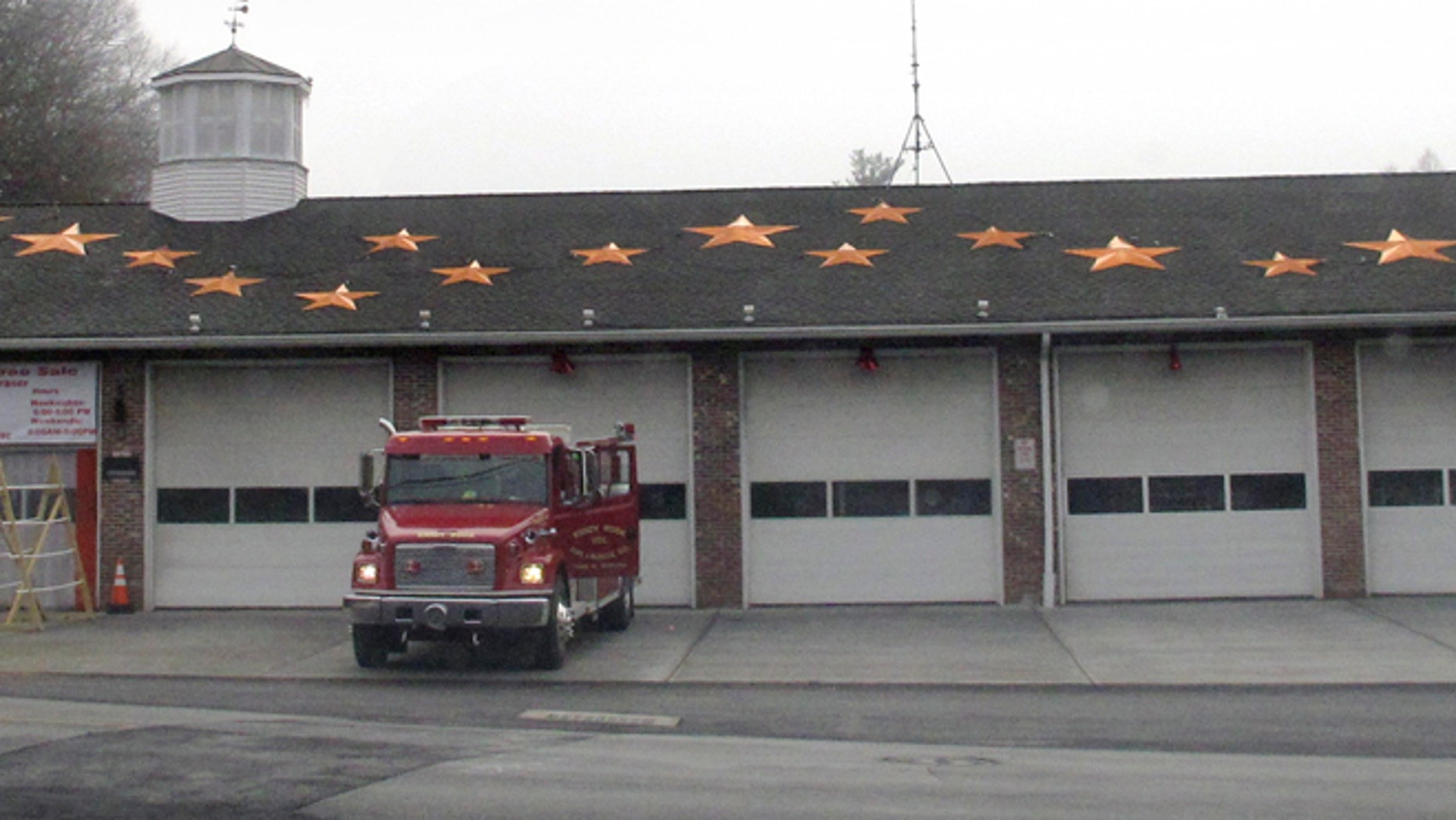 In this Friday, Dec. 11, 2015 photo, 26 stars decorate the roof of the Sandy Hook Volunteer Fire & Rescue Co. firehouse in Newtown, Conn. The stars are in memory of the victims of the Dec. 14, 2012 shooting at the adjacent to Sandy Hook Elementary School where 20 students and six adults were killed.