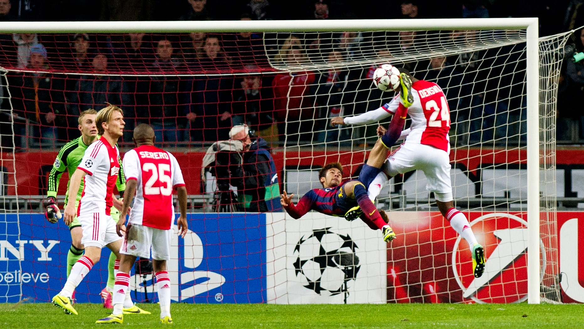 Barcelona's Neymar, second right, challenges Ajax's Stefano Denswil, first right, during the Group H Champions League soccer match between Ajax and FC Barcelona at the ArenA stadium in Amsterdam, Netherlands, Tuesday Nov. 26, 2013. (AP Photo/Patrick Post)