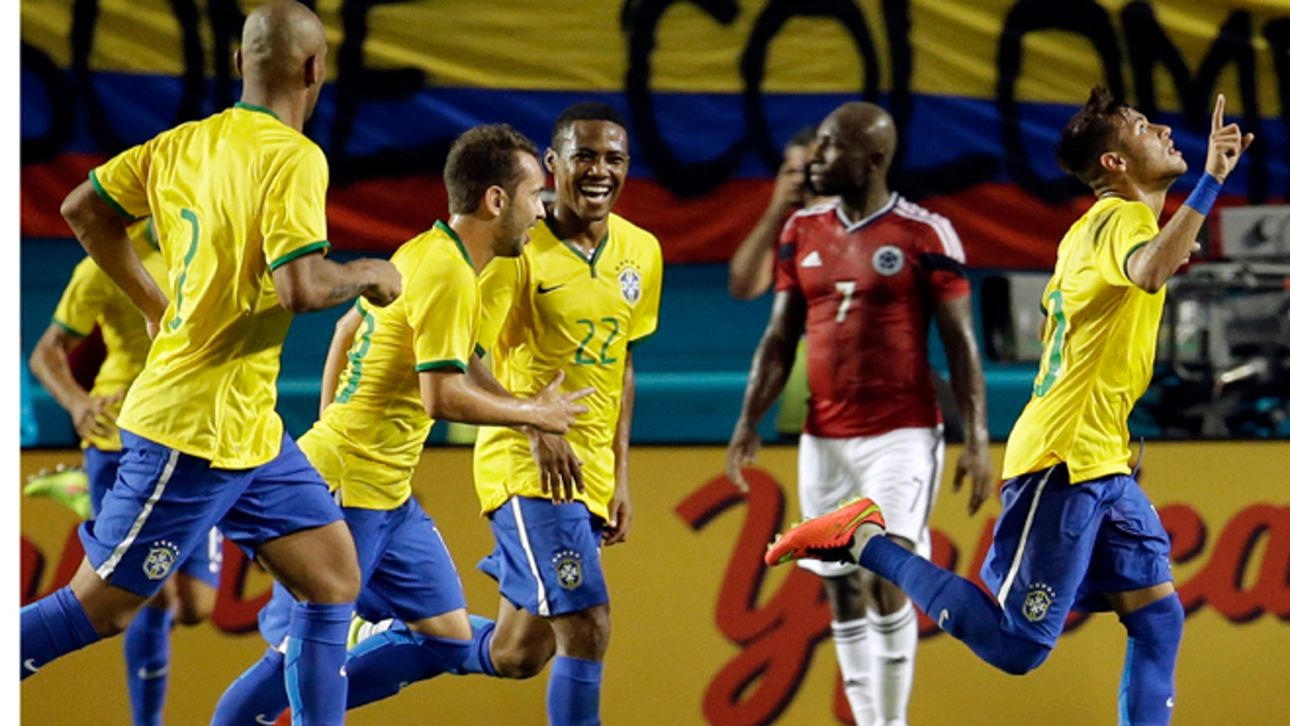Brazil's Neymar, right, celebrates after scoring a goal against Colombia in the second half of an international friendly soccer match, Friday, Sept. 5, 2014, in Miami Gardens, Fla. Brazil defeated Colombia 1-0. (AP Photo/Lynne Sladky)