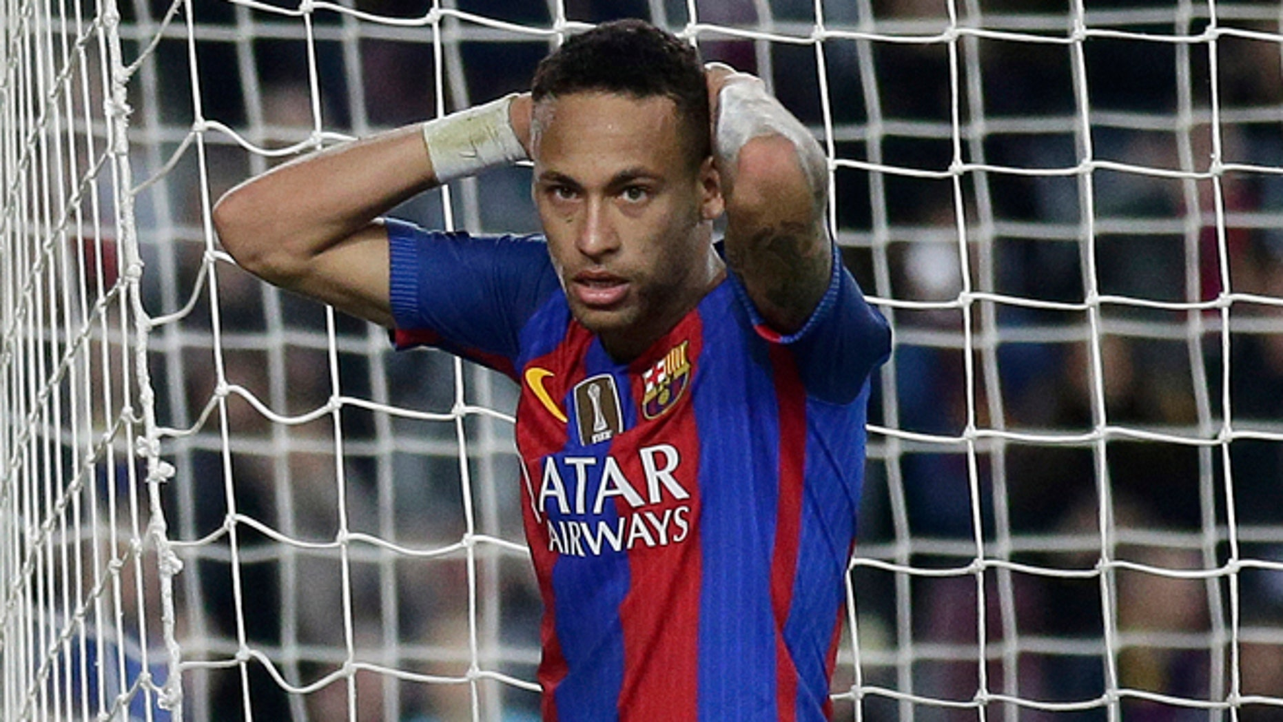 FILE - In this Saturday, Nov. 19, 2016 file photo, FC Barcelona's Neymar reacts during the Spanish La Liga soccer match between FC Barcelona and Malaga at the Camp Nou in Barcelona, Spain. Spanish prosecutors are seeking a two-year prison sentence and a $10.6 million fine for Neymar on corruption charges because of alleged irregularities during his transfer from Brazilian club Santos to Barcelona, it was reported on Wednesday, Nov. 23, 2016. (AP Photo/Manu Fernandez, File)