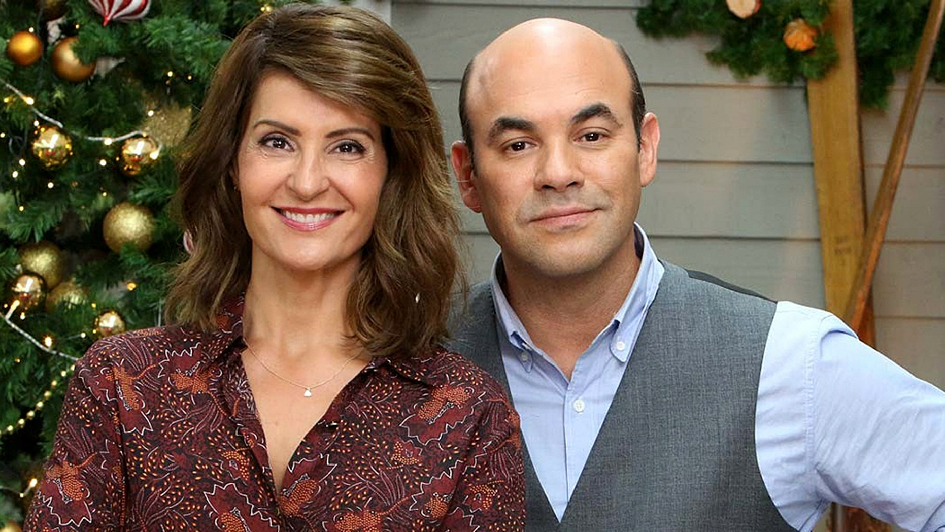 "Nia Vardalos and her husband, actor Ian Gomez, have annouced that they are getting a divorce after 25 years of marriage. Here the pair pose on set of ""The Great American Baking Show"" which the co-hosted together."