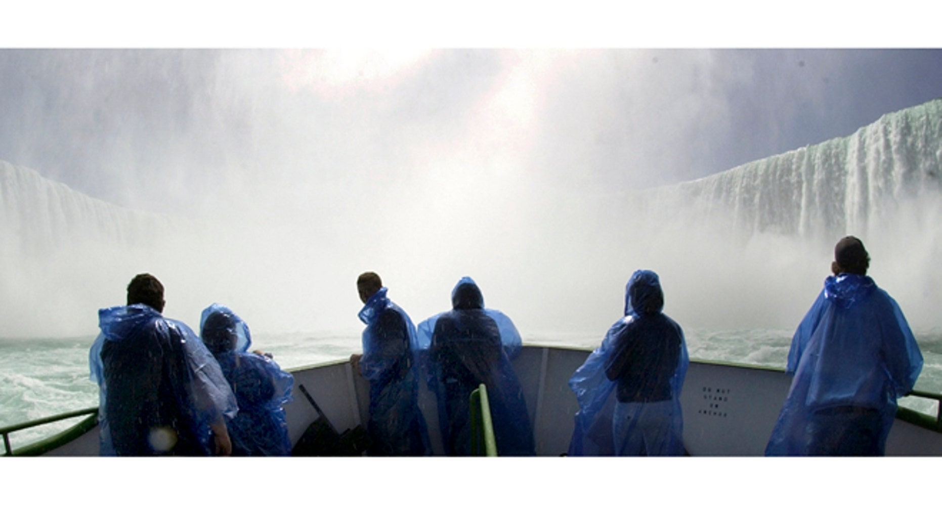 April 21, 2005: A group of tourists brave opening day on the bow of the Maid of the Mist at the base of the Horseshoe Falls.