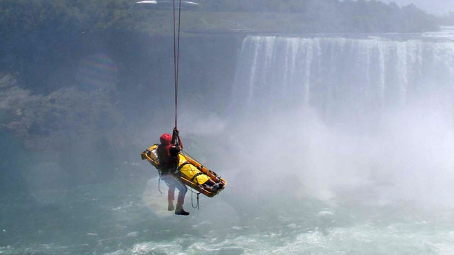 May 21, 2012: In this photo provided by Jared Fisk, Niagara Falls emergency officials rescue a man who plunged over Niagara Falls and survived in an apparent suicide attempt.