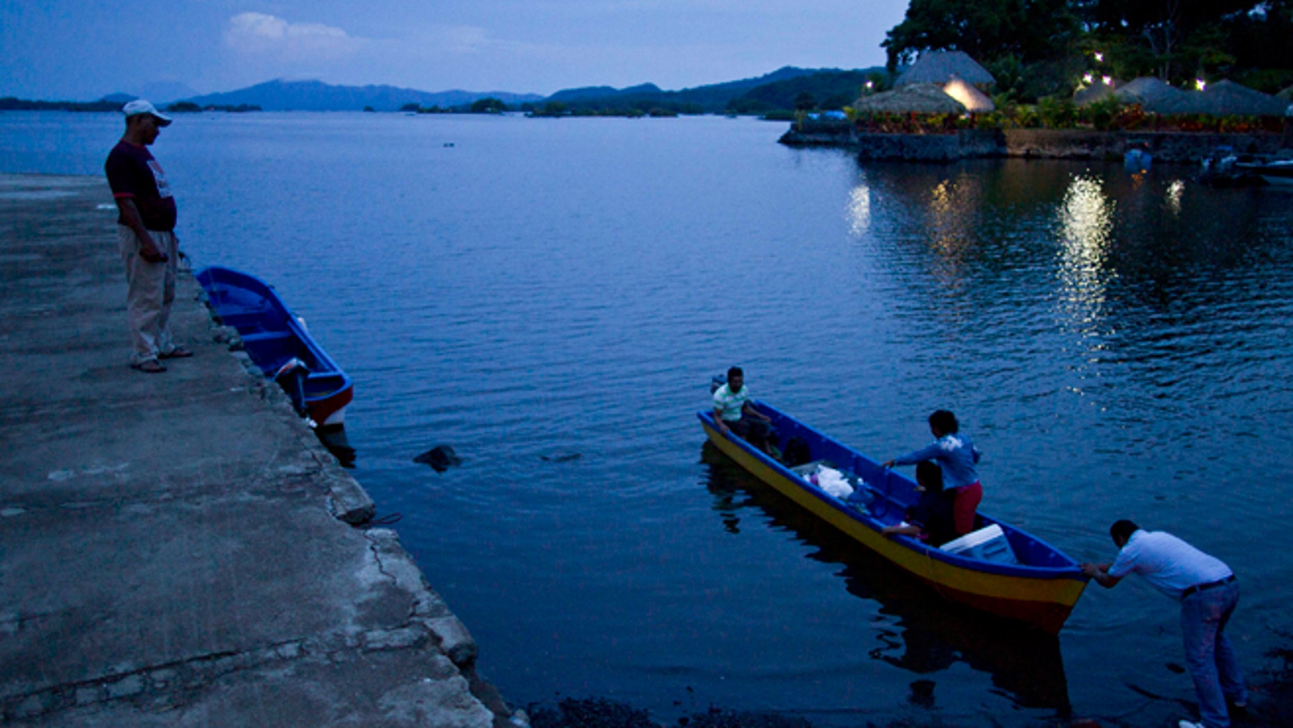 June 7, 2013: In this photo, people push a boat into Lake Nicaragua, near Granada, Nicaragua. A multi-billion dollar Chinese plan to plow a massive rival to the Panama Canal across the middle of Nicaragua was headed for approval by the leftist-controlled National Assembly Thursday, June 13, 2013, capping a lightning-fast approval process that has provoked deep skepticism among shipping experts and intense concern among environmentalists.