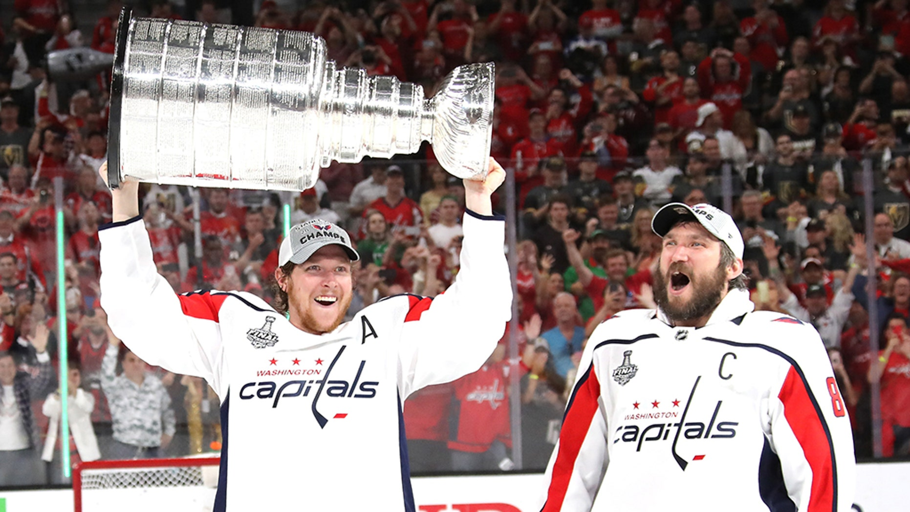LAS VEGAS, NV - JUNE 07:  Alex Ovechkin #8 hands of the Stanley Cup to Nicklas Backstrom #19 of the Washington Capitals after their team's 4-3 win over the the Vegas Golden Knights in Game Five of the 2018 NHL Stanley Cup Final at T-Mobile Arena on June 7, 2018 in Las Vegas, Nevada.  (Photo by Bruce Bennett/Getty Images)