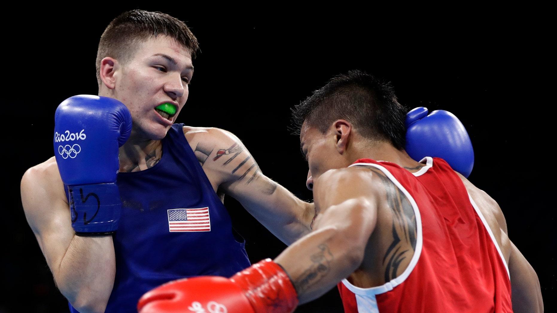 United States' Nico Miguel Hernandez, left, fights Ecuador's Carlos Eduardo Quipo Pilataxi on Aug. 10, 2016.