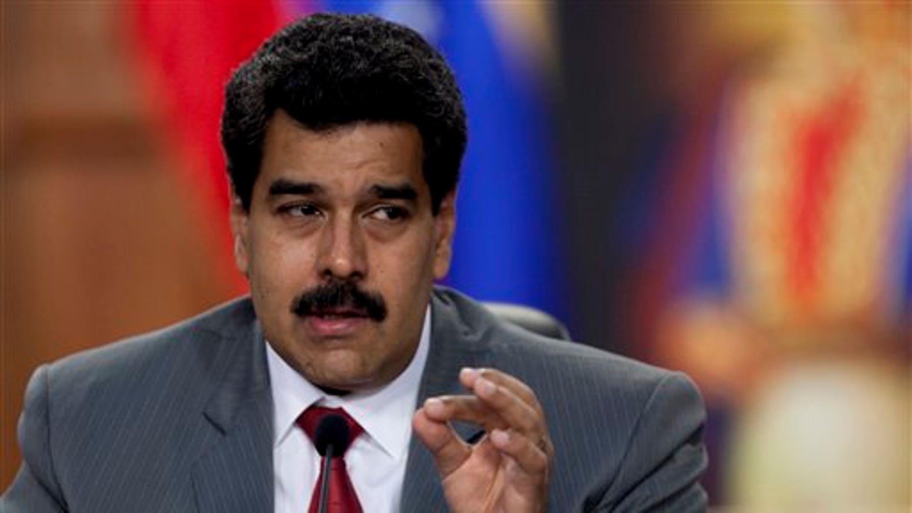 Venezuela's President Nicolás Maduro speaks during a press conference at the Miraflores presidential palace in Caracas, Venezuela, Friday, March 14, 2014.