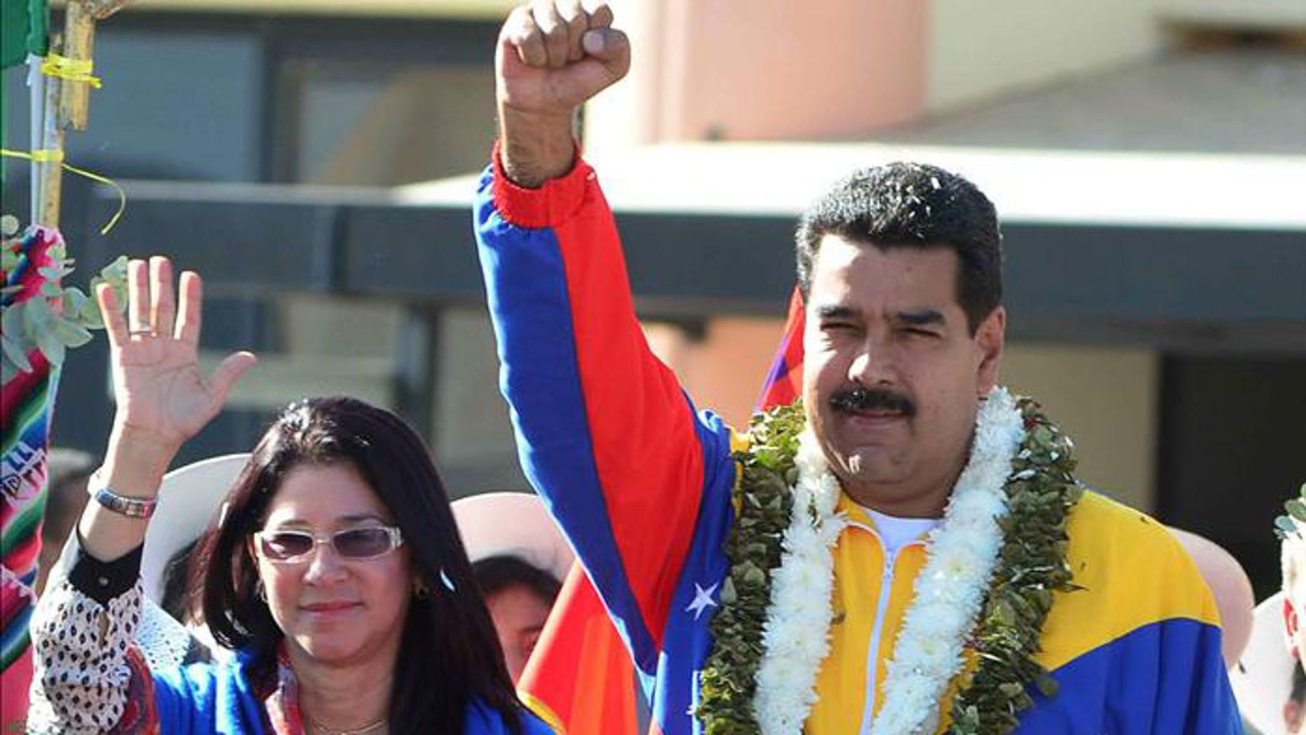 Venezuelan President Nicolas Maduro and his wife, Cilia Flores.
