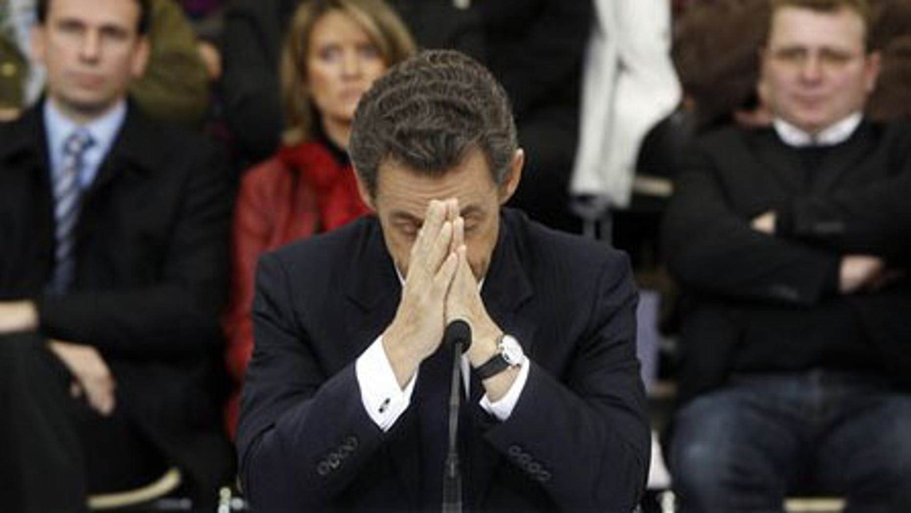French President Nicolas Sarkozy reacts during a meeting on agriculture, in  Mayet-de-Montagne, central France, Thursday Nov. 25, 2010. (AP Photo/Laurent Cipriani)