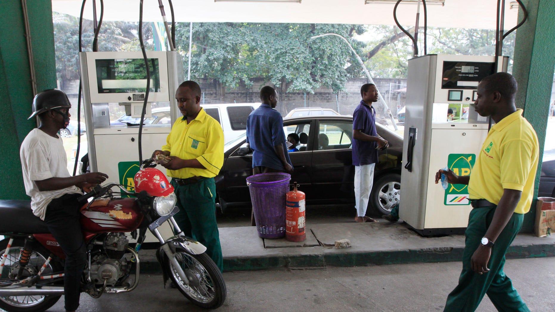 Jan. 2, 2012: People buy fuel at a petrol station in Lagos ,Nigeria.