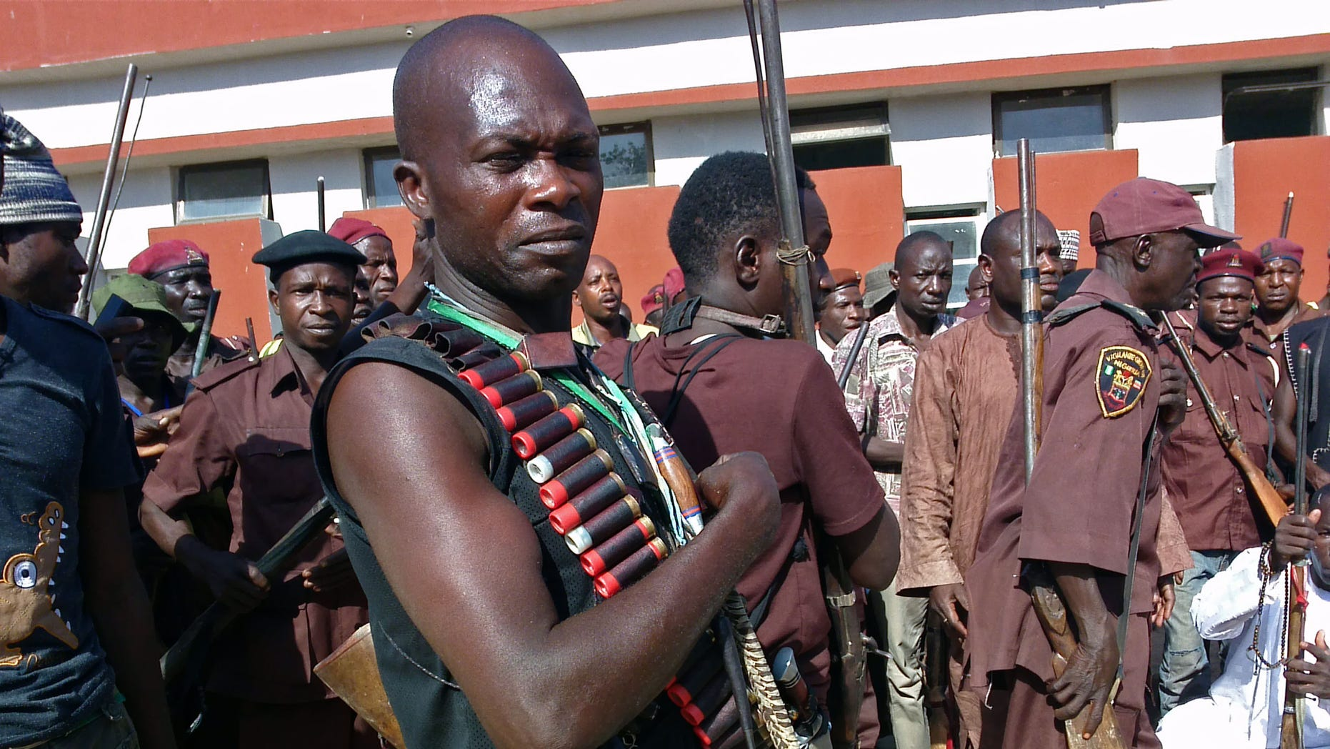 May 18, 2014 - Armed hunters gather before looking for 276 abducted school girls in Maiduguri, Nigeria. Hundreds of hunters armed with homemade rifles, poisoned arrows and amulets say their spiritual powers can lead them to the girls abducted by Islamic extremists.