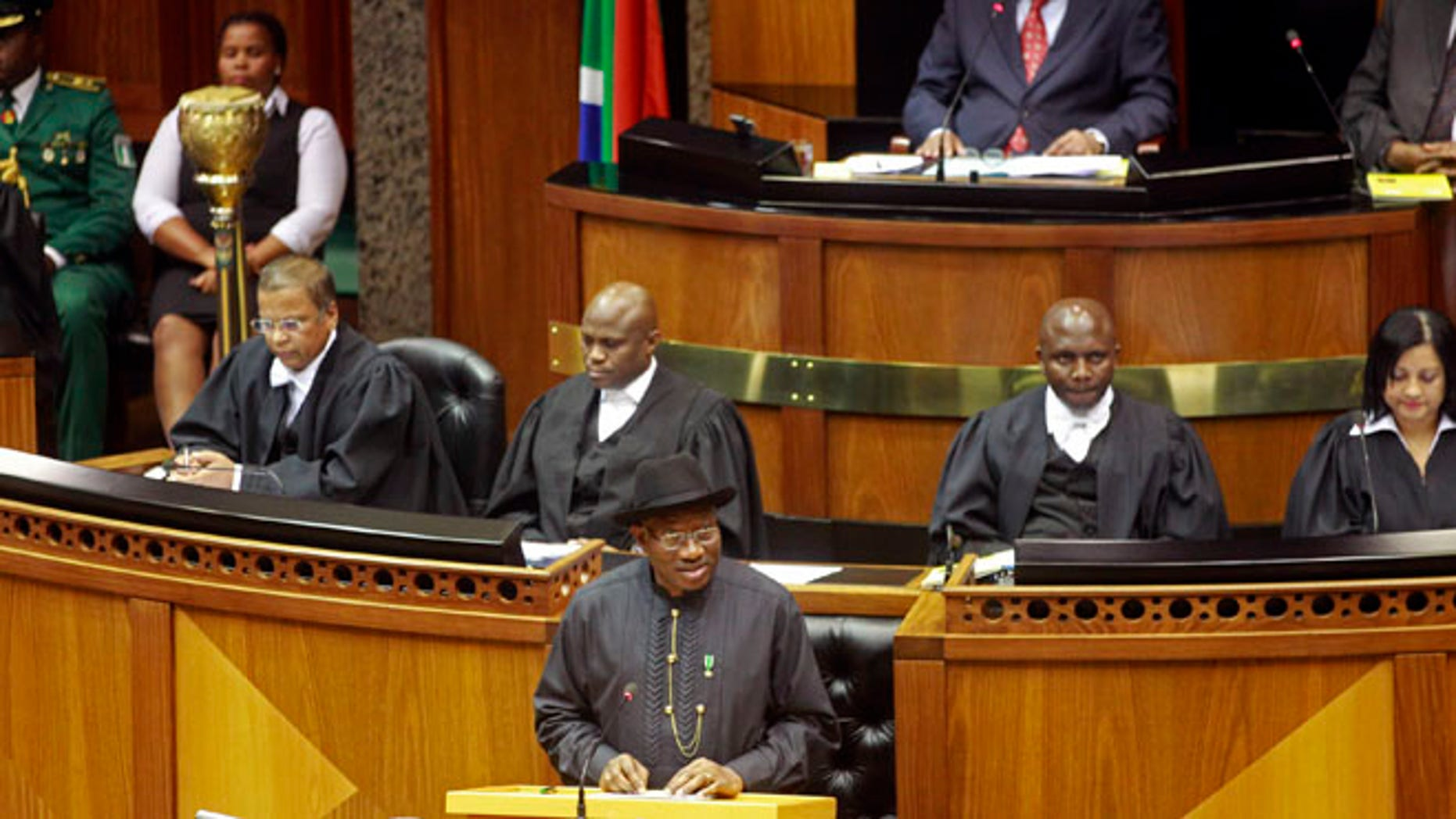 May 7, 2013: Nigerian President Goodluck Jonathan, center, makes a speech in the South African Parliament in Cape Town.