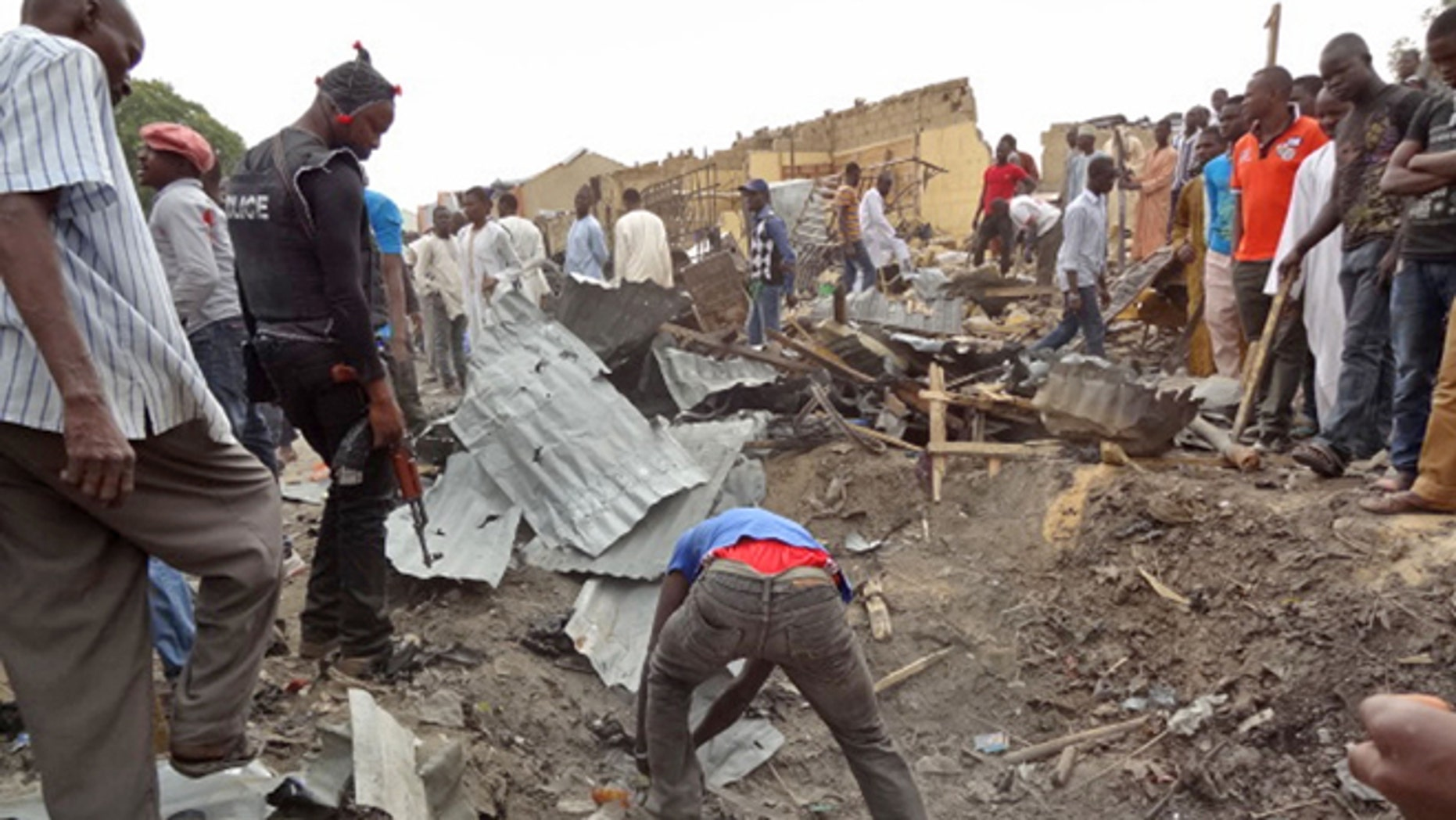 March 2, 2014: People search the area where a twin car bomb exploded in Maiduguri, Nigeria.