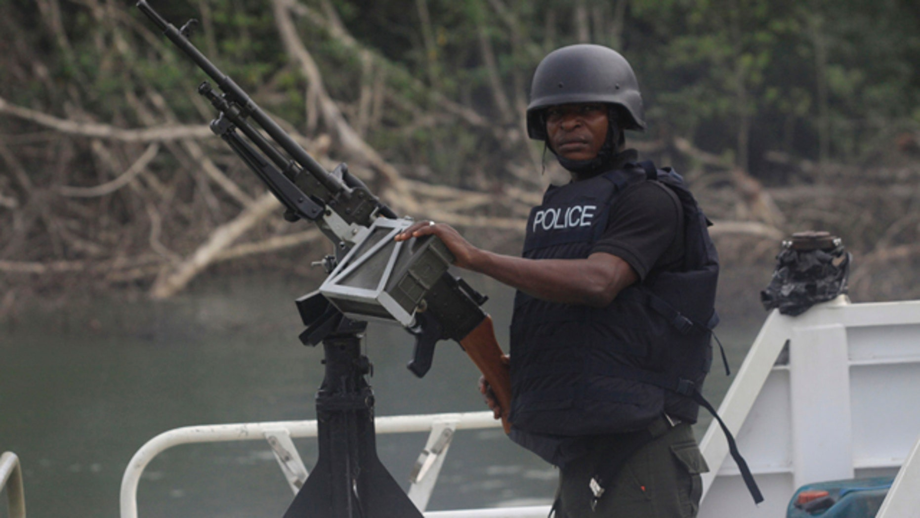 Feb. 27: A police officer mans a jetty prior to Nigeria President Goodluck Jonathan's visit to Koluama 2 village, in Nigeria.