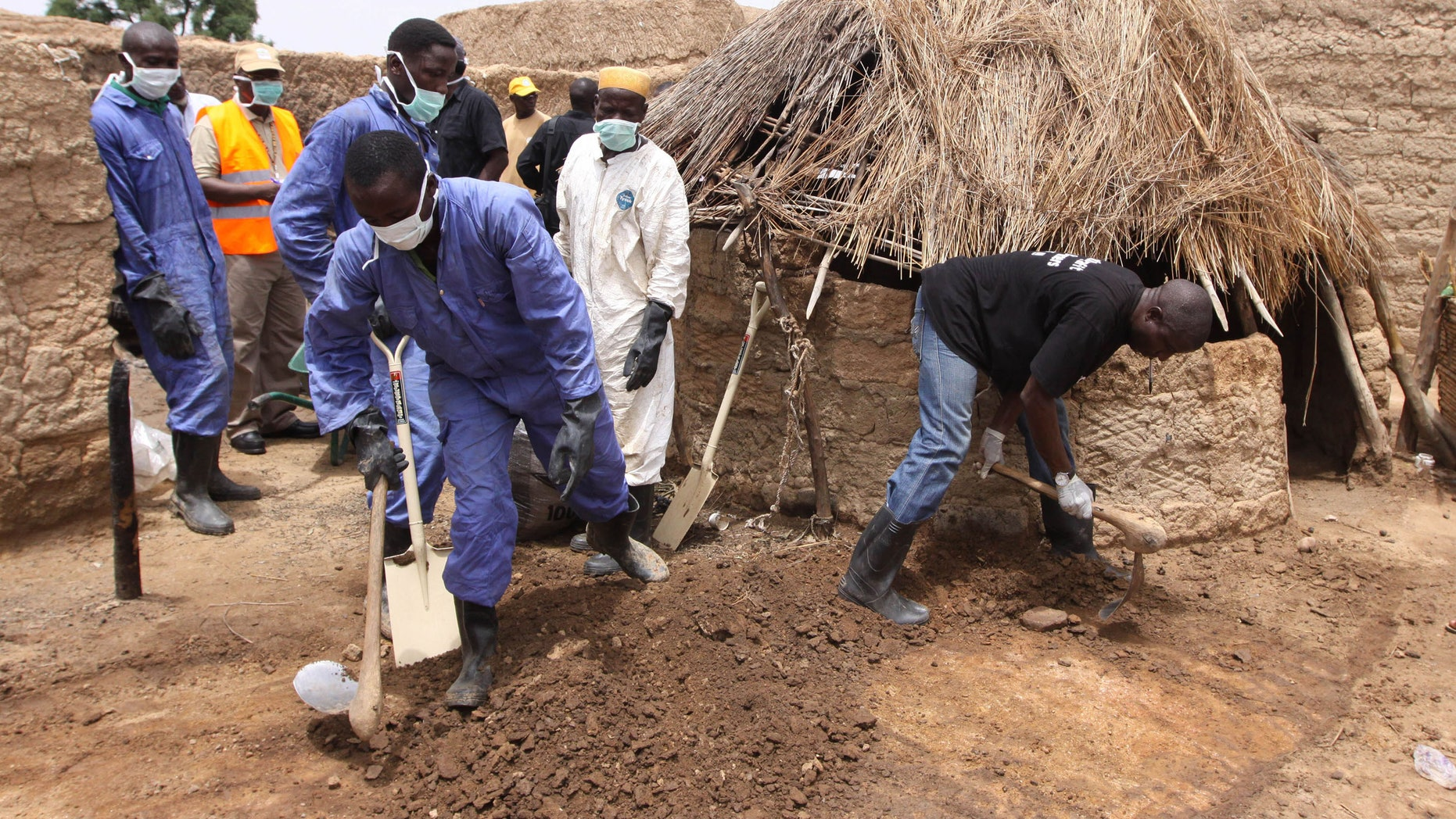 Local health workers removing earth contaminated by lead from a family compound in the village of Dareta in Gusau, Nigeria.