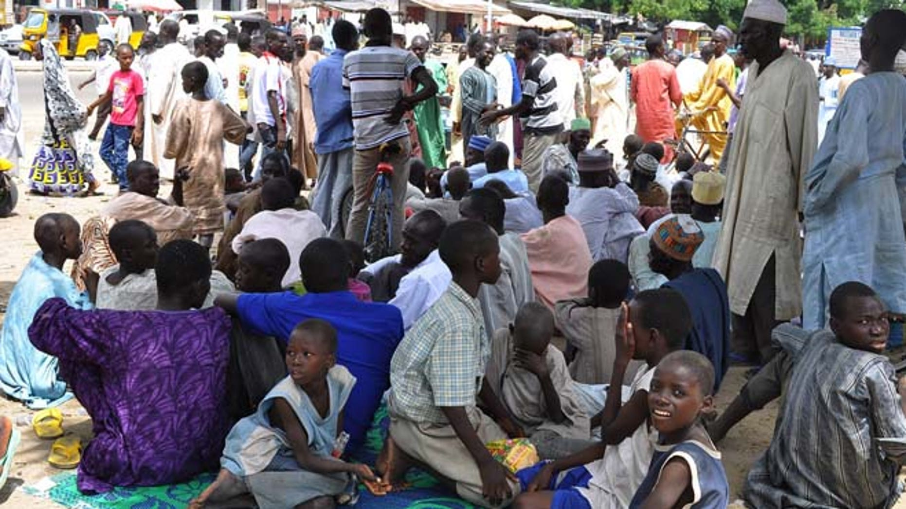 Sept. 3, 2014: Civilians who fled their homes following an attacked by Islamist militants in Bama, take refuge at a School in Maiduguri, Nigeria. (AP)
