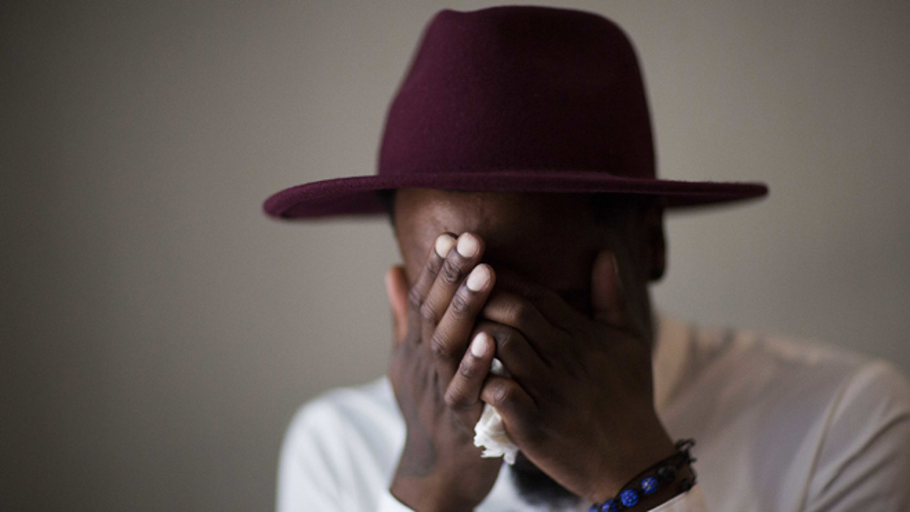 Demetrice Naulings cries while recalling how he survived the Pulse shooting on June 14, 2016, in Orlando, Fla.