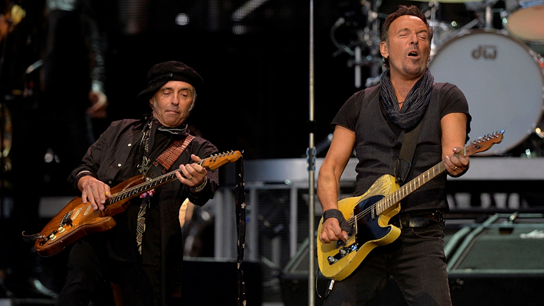 Nils Lofgren, left, guitarist of Bruce Springsteen's E Street Band, had four guitars and other equipment stolen before his Dallas show.