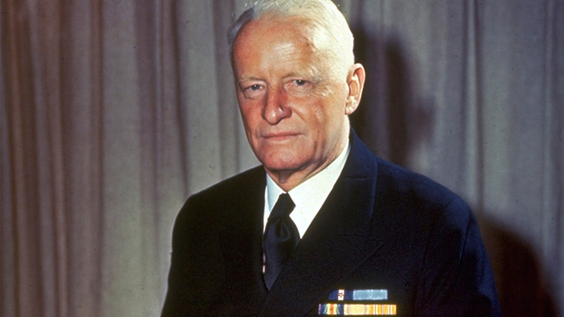 This undated file photo shows Adm. Chester W. Nimitz, commander of U.S. Naval forces in the Pacific during World War II, sitting on a desk in an unknown location.